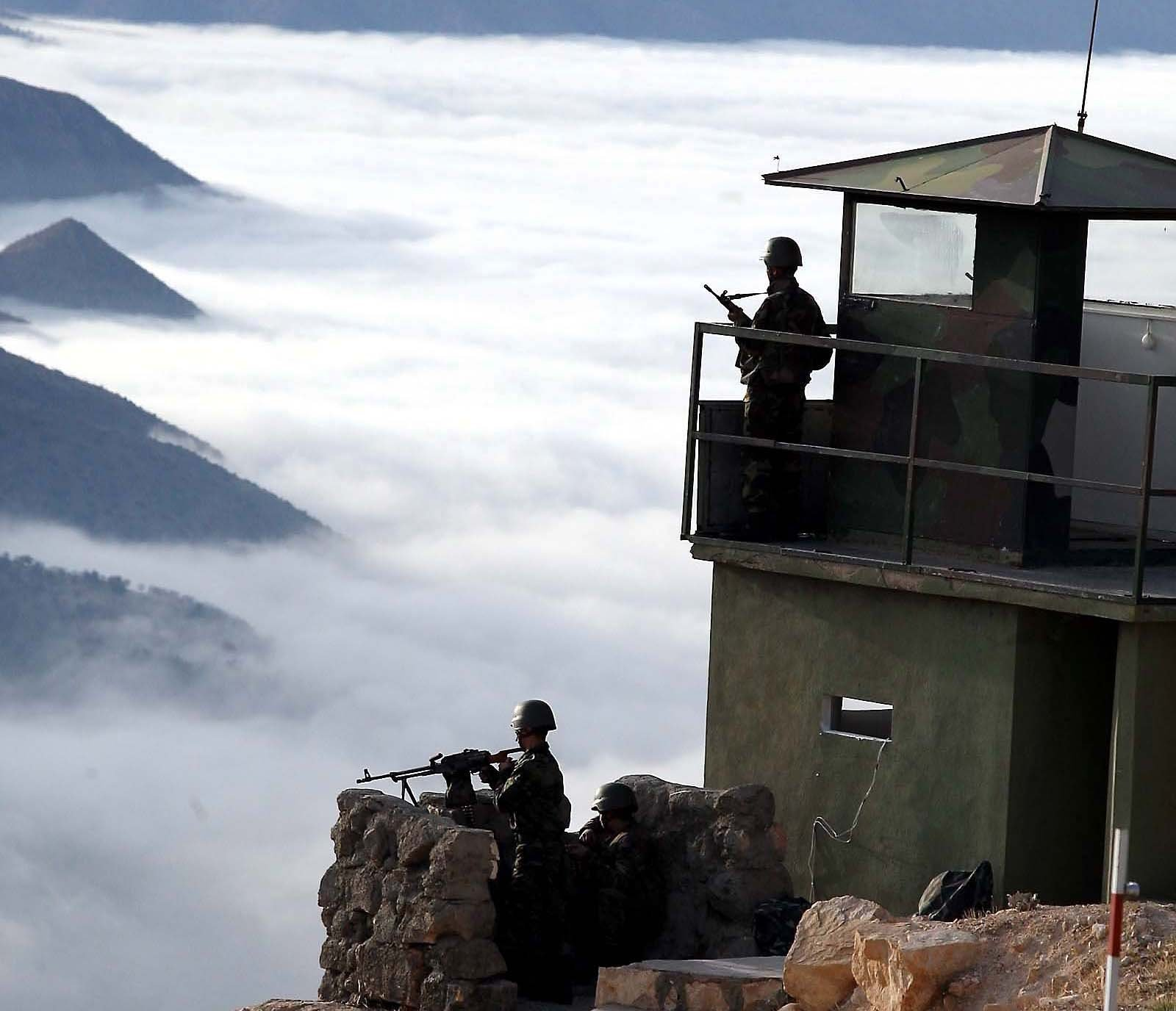 Turkish soldiers stand on guard duty near Beyirdüzü, Eruh district in Turkey's Siirt province in this undated file photo. (Sabah File Photo)