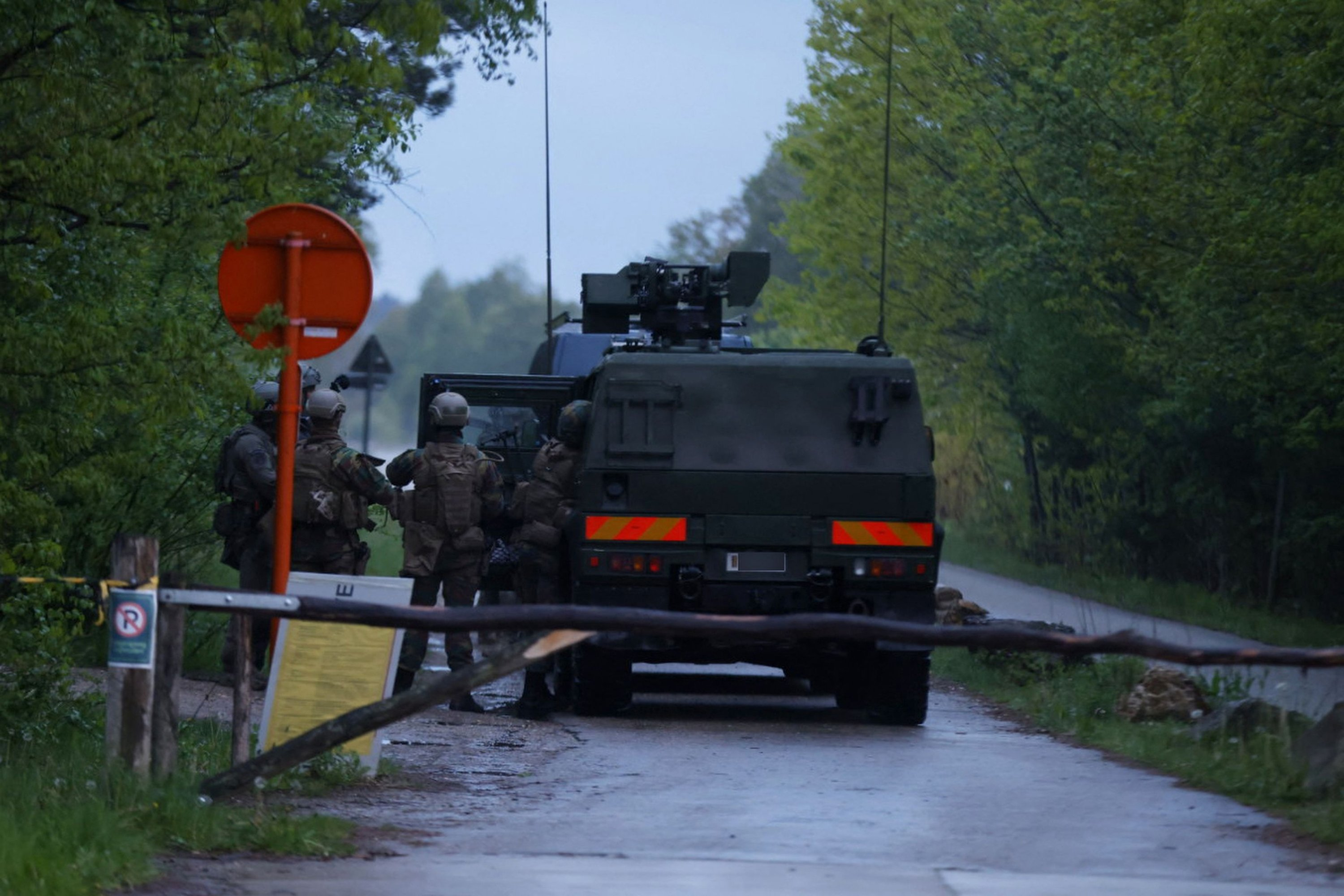 Military special forces arrive with an army armored truck, at the forest of National Park Hoge Kempen in Dilsen-Stokkem, on May 19, 2021 as authorities are looking for a heavily armed professional soldier, Jurgen Conings, in the province of Limburg, since May 18, 2021. (Photo: James Arthur Gekiere/Belga via AFP)