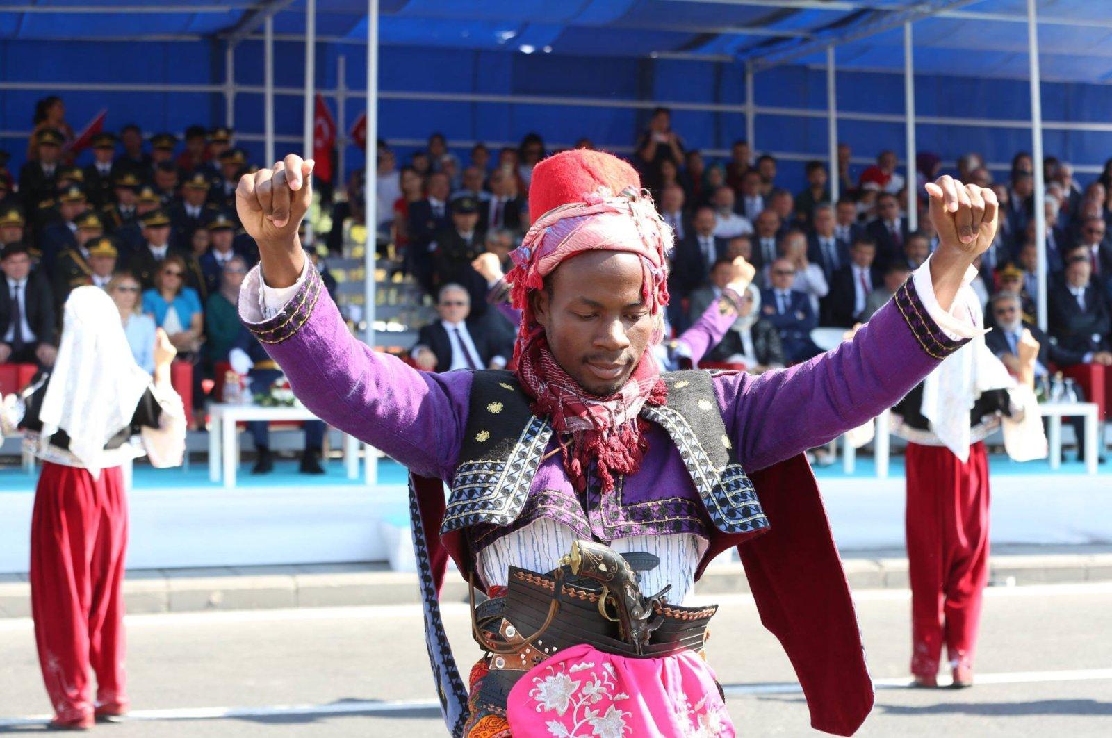 A Ugandan student performs Turkish folkloric dance in Kayseri, Turkey, Aug. 30, 2018. (Photo by Ali Altundaş)