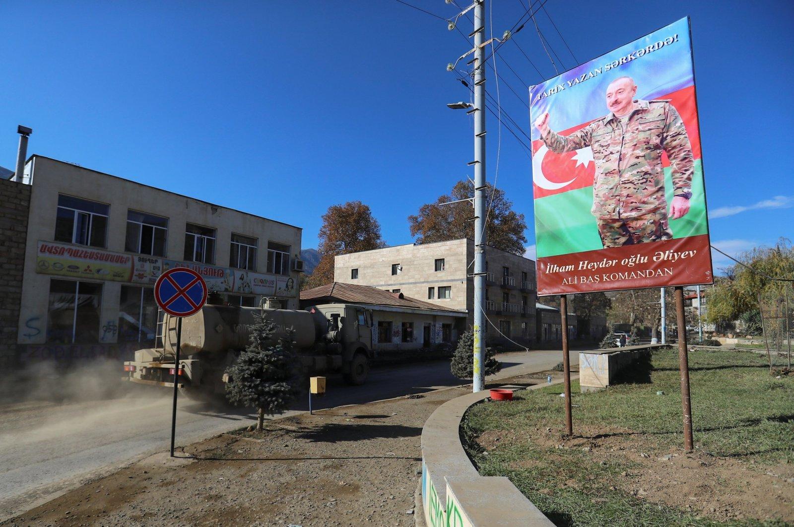 A board with an image of Azerbaijani President Ilham Aliyev is on display in Hadrut town in the region of Nagorno-Karabakh, Azerbaijan, Nov. 25, 2020. (REUTERS)