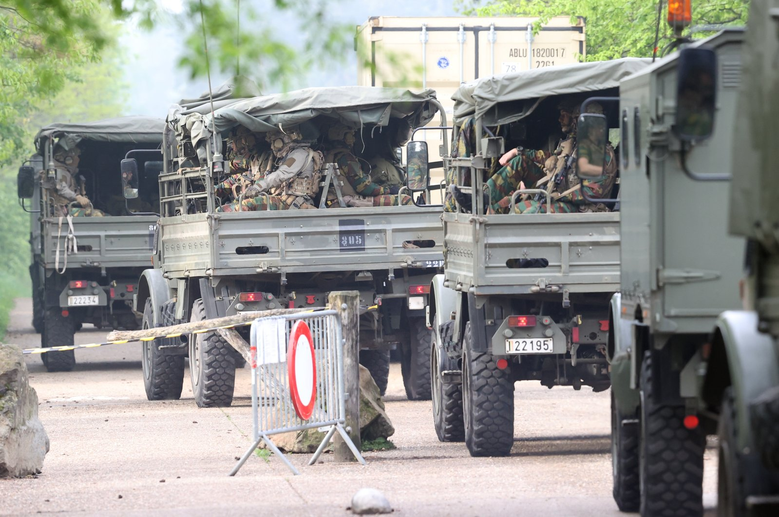 Soldiers in military trucks are deployed in the area where heavily armed and far-right linked Jurgen Conings is believed to be located, in the Limburg province, Belgium, May 20, 2021. (AA Photo)