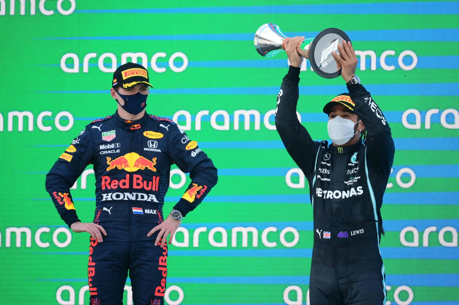 Mercedes' British driver Lewis Hamilton (R) celebrates on the podium next to Red Bull's Dutch driver Max Verstappen after the Spanish Grand Prix at the Circuit de Catalunya, Barcelona, Spain, May 9, 2021. (AFP Photo)