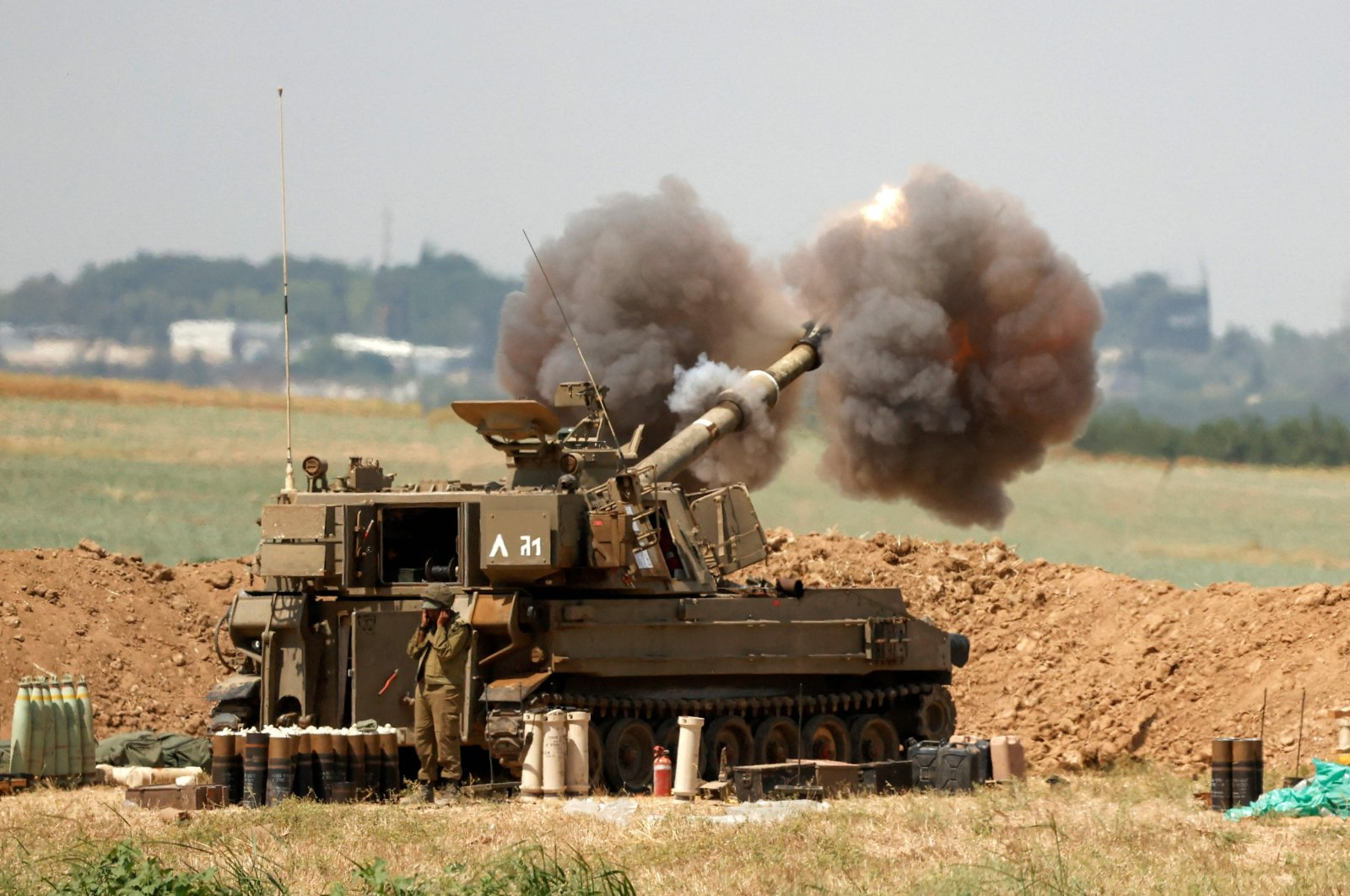 An Israeli 155mm self-propelled howitzer fires artillery shells towards the Gaza Strip from their position along the border with the Palestinian enclave, Israel, May 20, 2021. (AFP Photo)