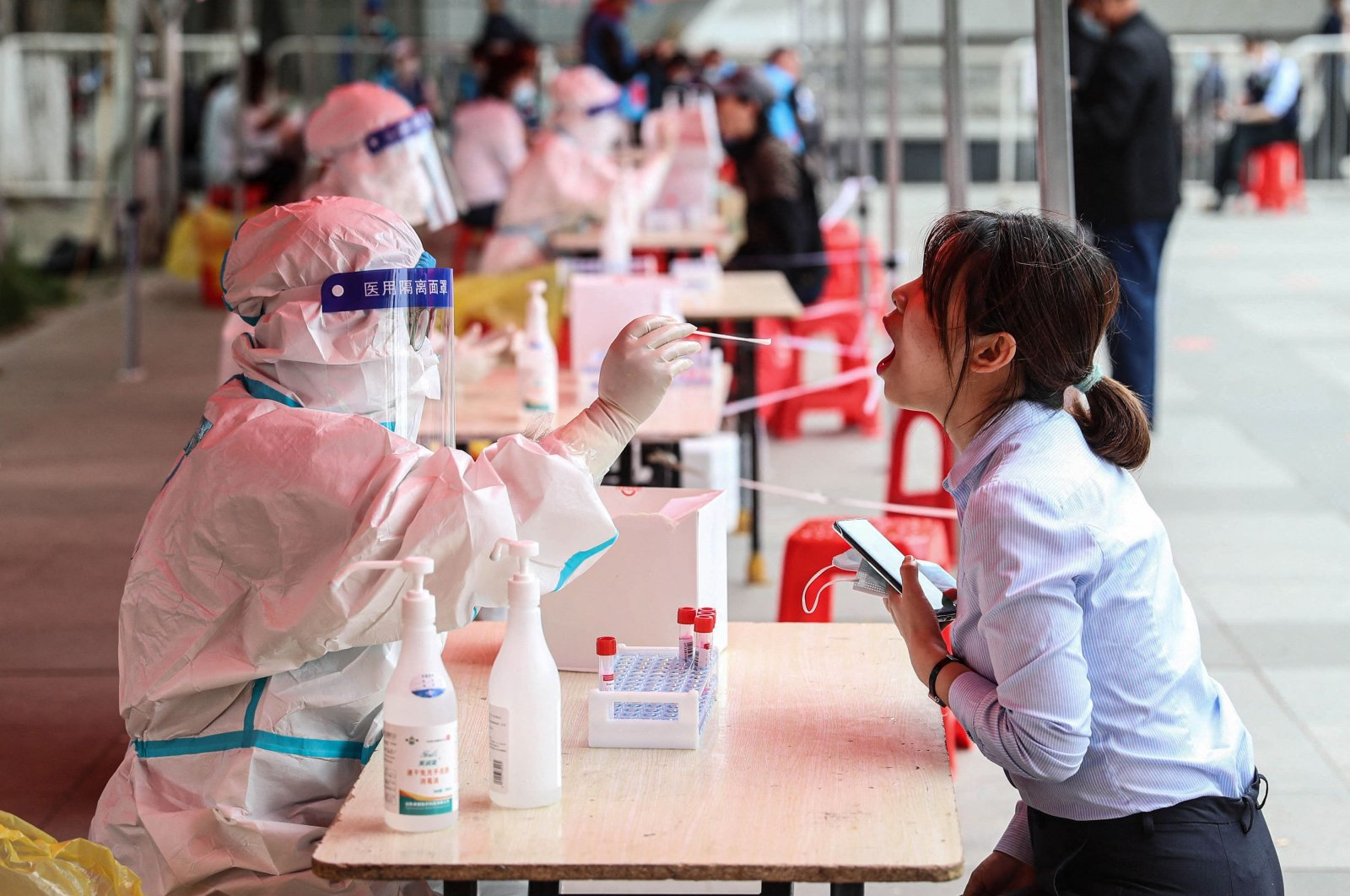 A health worker takes a swab sample from a resident to test for the COVID-19 coronavirus in Shenyang, in northeastern China's Liaoning province, May 20, 2021. (AFP Photo)