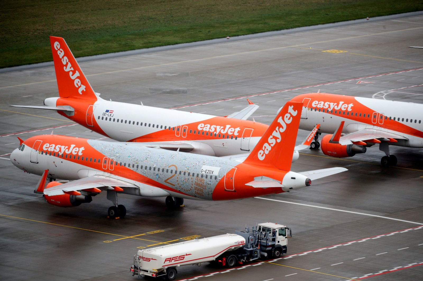 """EasyJet airplanes are parked on the tarmac during the official opening of the new Berlin-Brandenburg Airport (BER) """"Willy Brandt,"""" in Schoenefeld near Berlin, Germany, Oct. 31, 2020. (Reuters Photo)"""