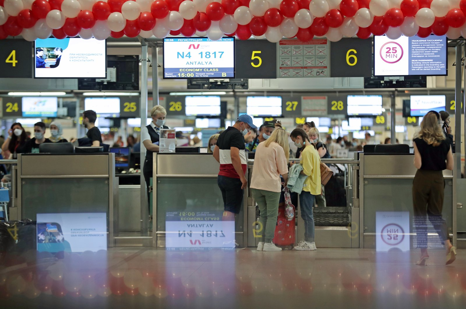 Passengers at Domodedovo International Airport, which has resumed flights to Turkey's resort cities of Antalya, Bodrum, and Dalaman after a pause, Moscow, Russia, Aug.10, 2020. (GettyImages)