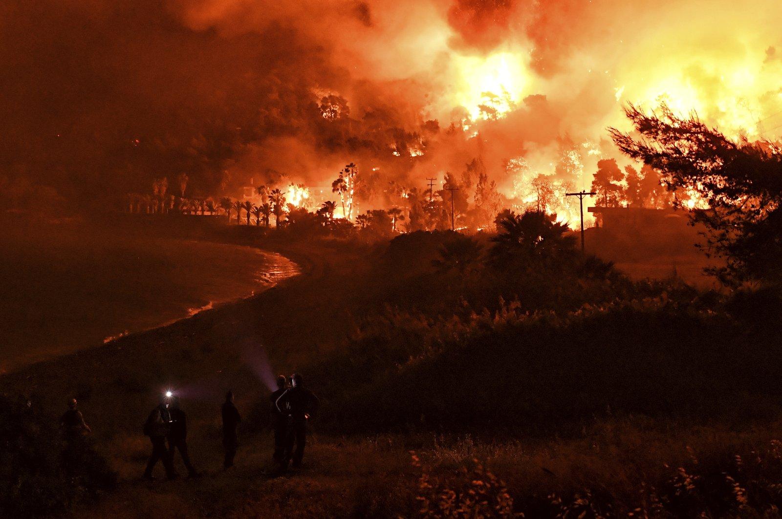 Wildfires burn near the village of Schinos, near Corinth, Greece, May 19, 2021. (AP Photo)