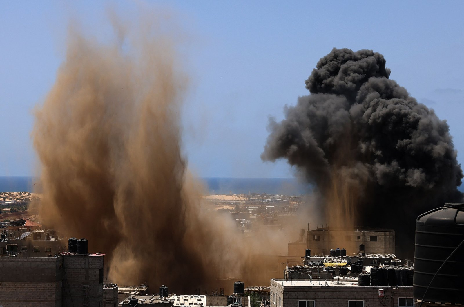 A building is hit during an Israeli airstrike in Rafah in the southern Gaza Strip, Palestine, May 20, 2021. (AFP Photo)