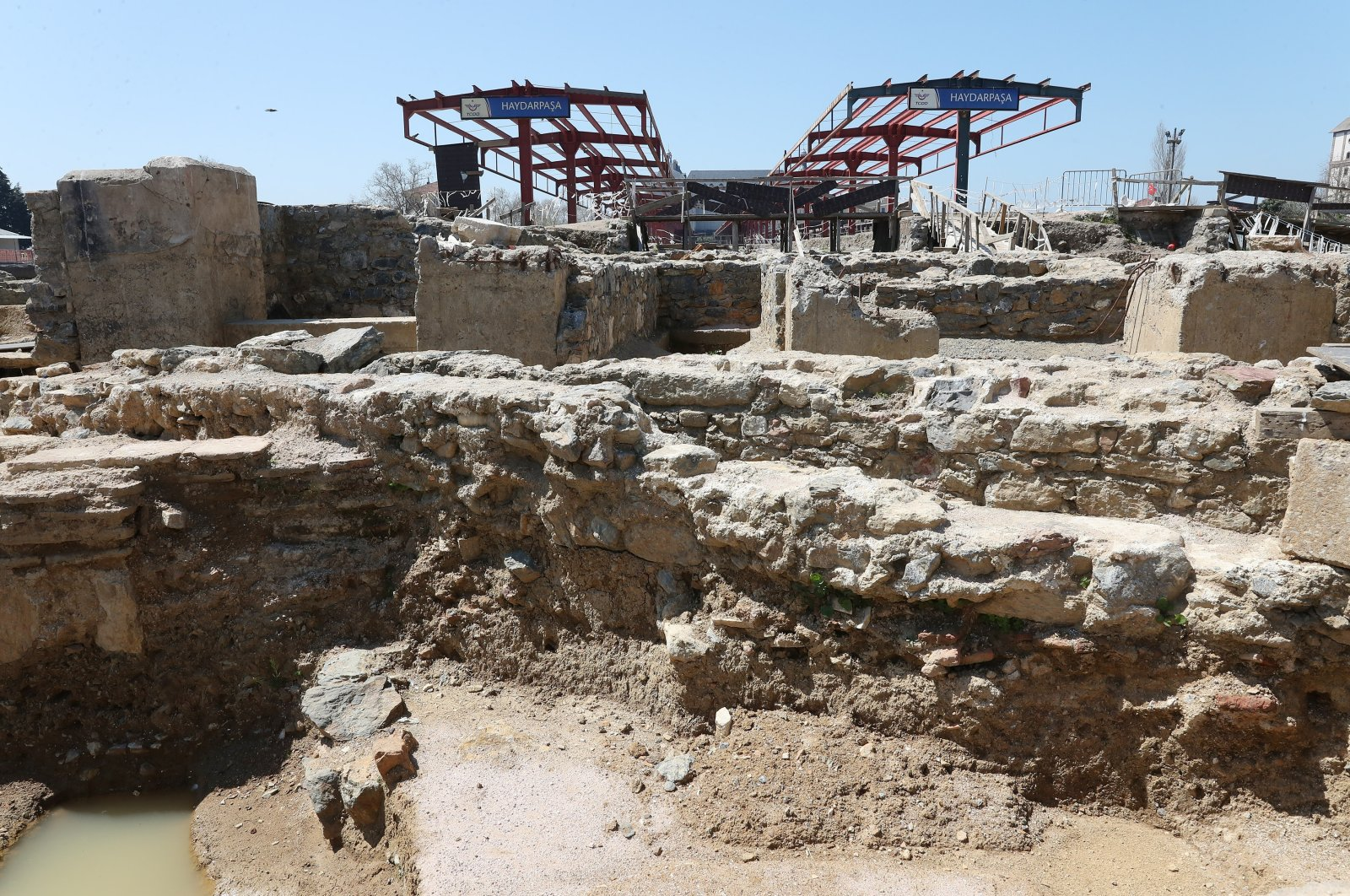 Excavations reveal ancient structures that can be seen against the backdrop of the out-of-use Haydarpaşa Train Station's platforms in theKadıköy district of Istanbul, Turkey, May 17, 2021. (DHA Photo)