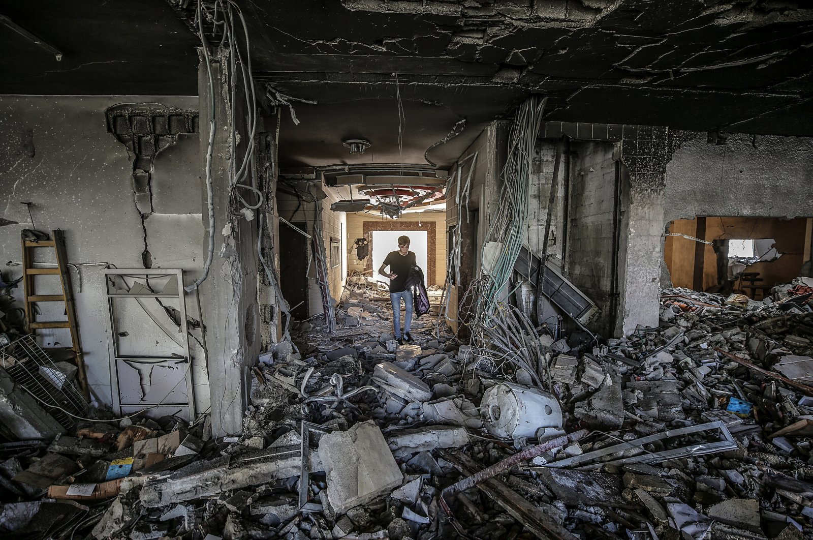 A Palestinian inspects his destroyed house after Israeli airstrikes in Gaza Strip, Palestine, May 20, 2021. (EPA Photo)