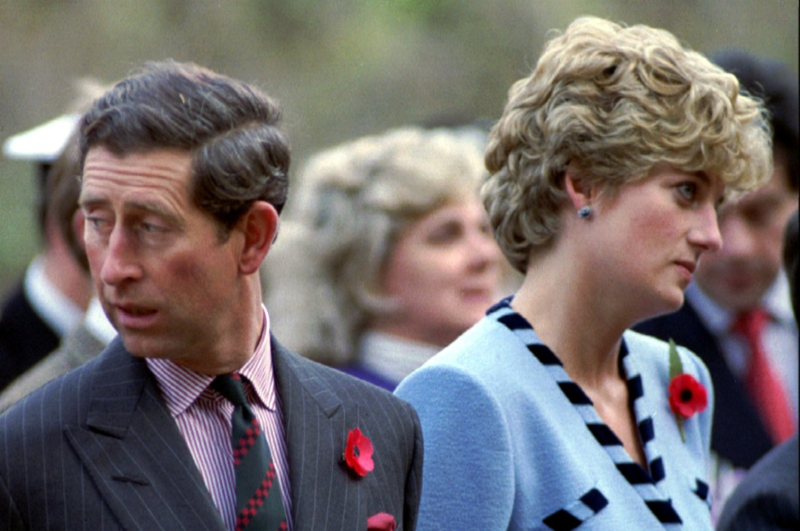 Princess Diana and Prince Charles look in different directions during a service held to commemorate the 59 British soldiers killed in action during the Korean war, Nov. 3, 1992. (Reuters Photo)