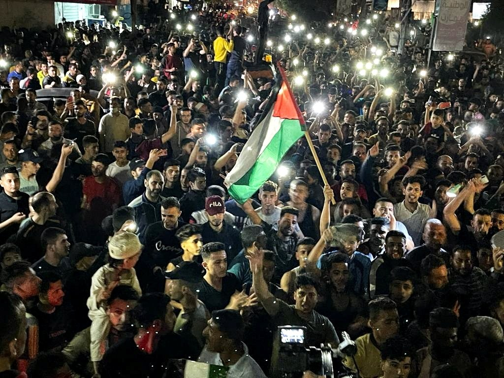 Palestinians celebrate in the streets following a cease-fire, in the southern Gaza Strip, Palestine, May 21, 2021. (Reuters Photo)