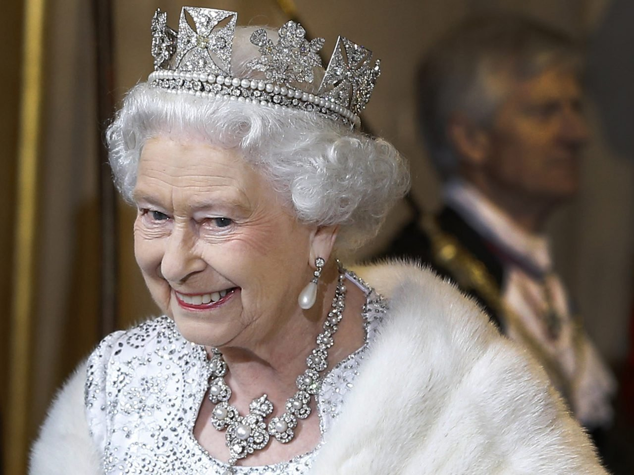 Queen Elizabeth II smiles as she leaves the State Opening of Parliament at the House of Lords on May 8, 2013 in London, England. (Getty Images)