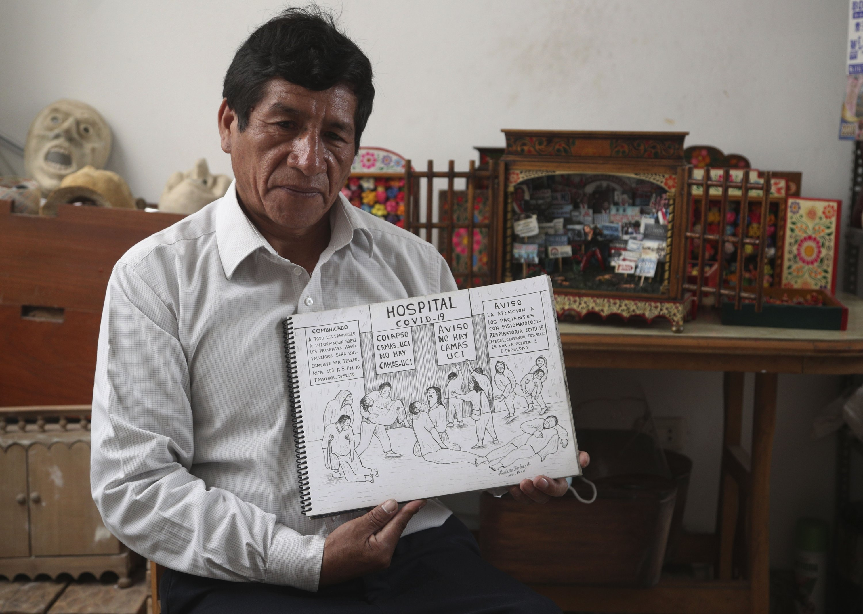 Edilberto Jimenez poses with one of his drawings at his home in San Juan de Lurigancho, on the outskirts of Lima, Peru, May 20, 2021. (AP Photo)