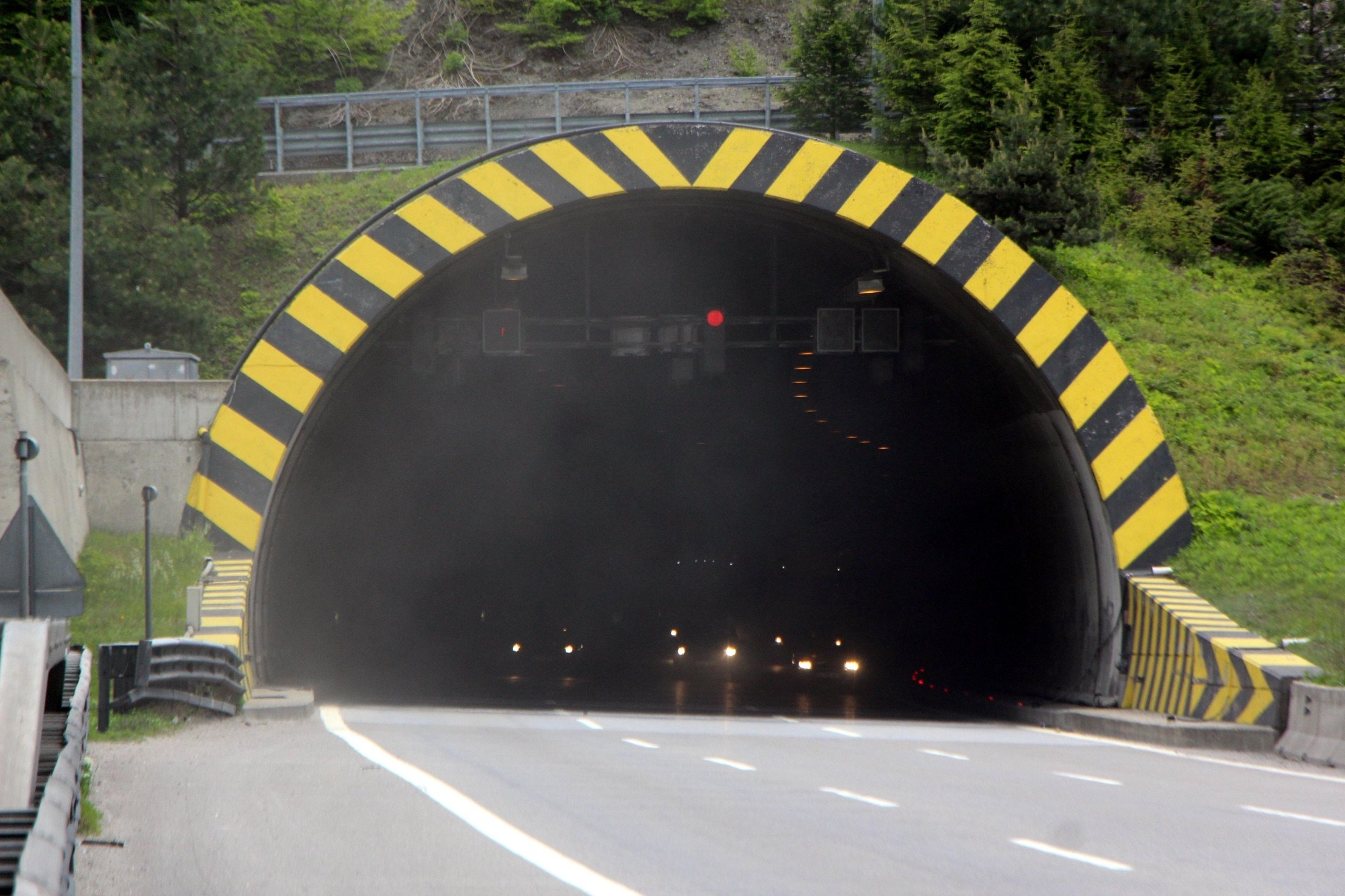 Car headlights are seen emerging from the darkness as they exit the Mount Bolu Tunnel in Bolu, Turkey, May 16, 2021. (DHA Photo)