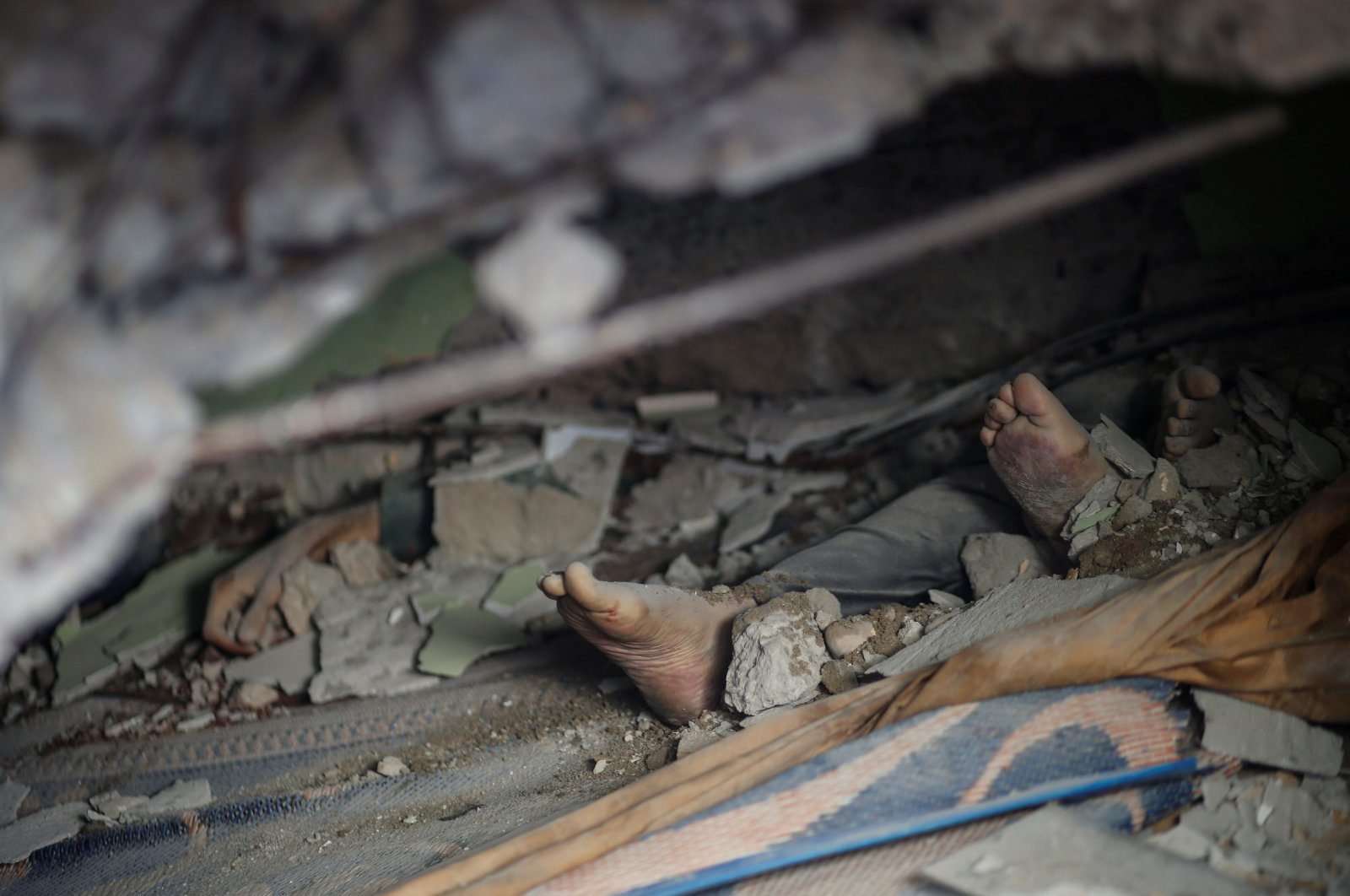 The bodies of victims killed by deadly Israeli bombardments are seen amid rubble in Gaza City, Palestine, May 16, 2021. (Reuters Photo)