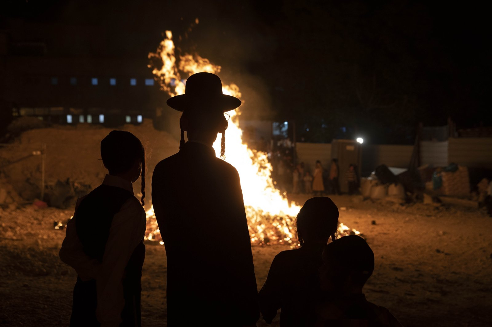 Ultra-Orthodox Jewish youths stand next to a bonfire in western Jerusalem, Israel, April 29, 2021. (AP Photo)