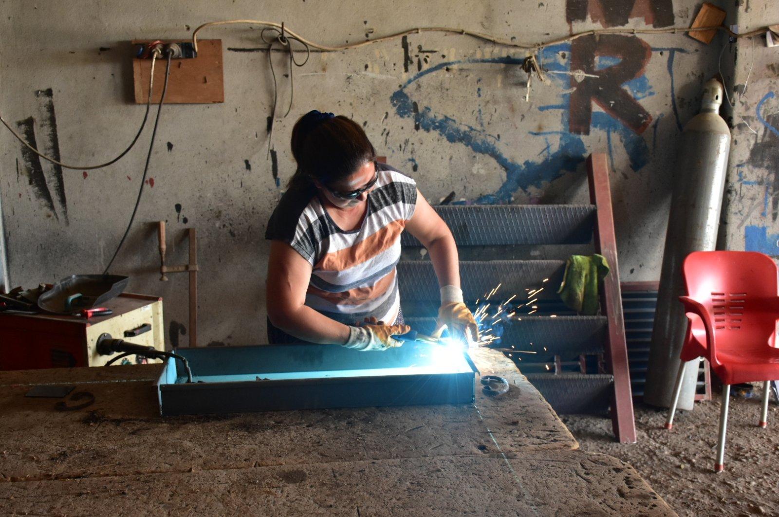 Welder Hayriye Arslan is seen in her workshop in Adana, southern Turkey, May 20, 2021. (DHA Photo)