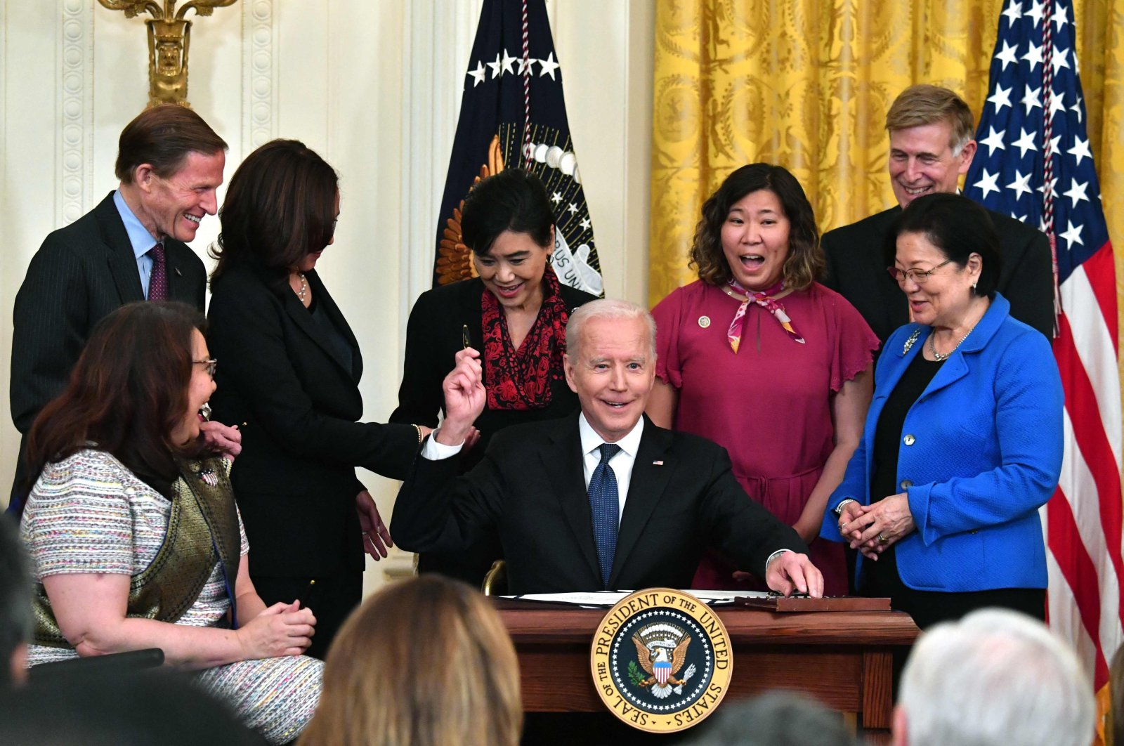 U.S. President Joe Biden smiles after signing into law a new bill addressing hate crimes against Asian Americans, in the East Room of the White House in Washington, D.C., U.S., May 20, 2021. (AFP Photo)