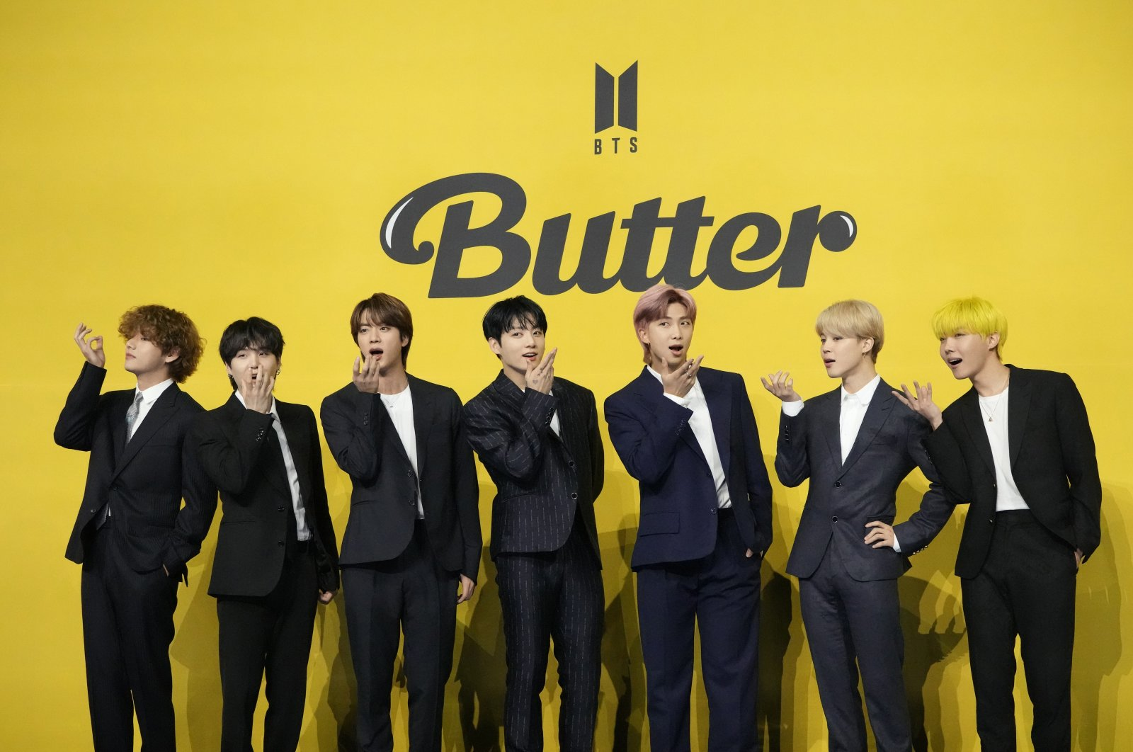 """Members of South Korean K-pop band BTS pose for photographers ahead of a press conference to introduce their new single """"Butter"""" in Seoul, South Korea, May 21, 2021. (AP Photo)"""