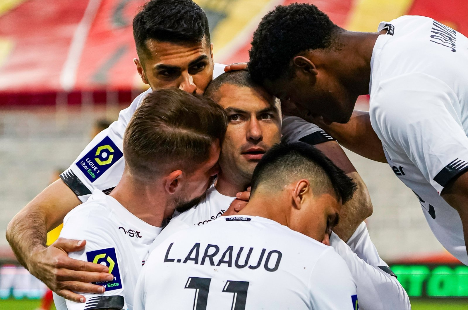Lille's Burak Yılmaz (C) celebrates a goal with his teammates during a Ligue 1 match against Lens at the Stade Bollaert-Delelis in Lens, France, May 7, 2021. (IHA Photo)