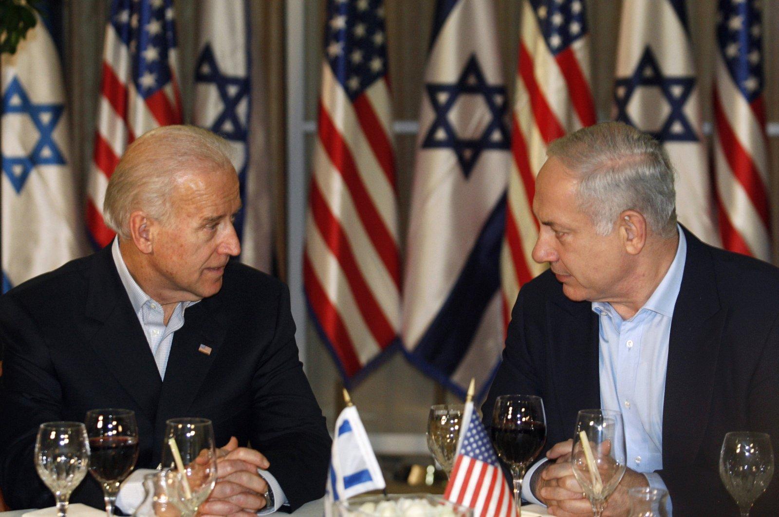 Then U.S. Vice President Joe Biden (L) and Israeli Prime Minister Benjamin Netanyahu talk while having dinner at Netanyahu's residence in western Jerusalem, March 9, 2010. (AP Photo)
