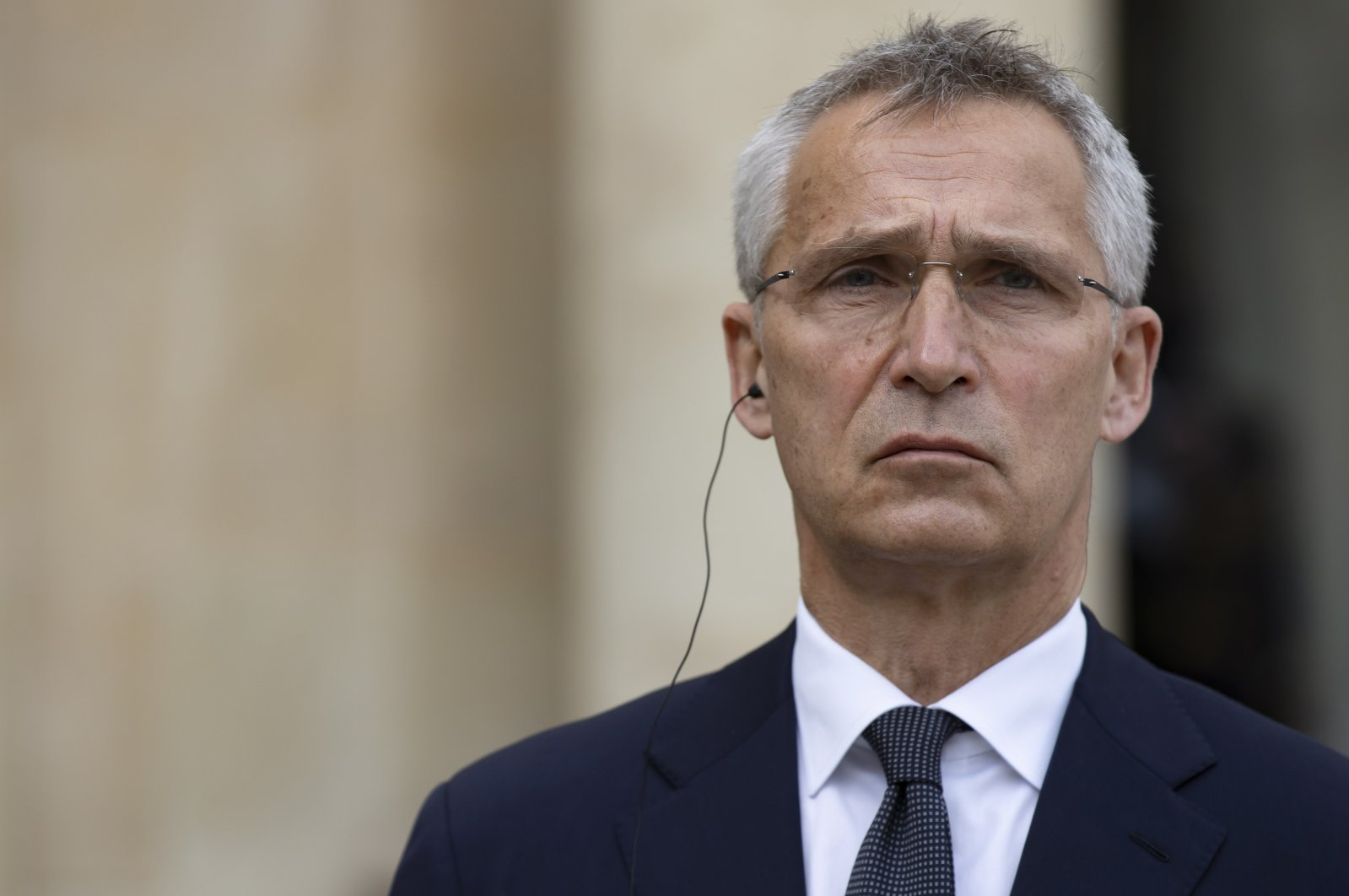 NATO Secretary-General Jens Stoltenberg looks on during a joint statement with French President Emmanuel Macron after their meeting at the Elysee Palace, Paris, France, 21 May 2021. (EPA Photo)