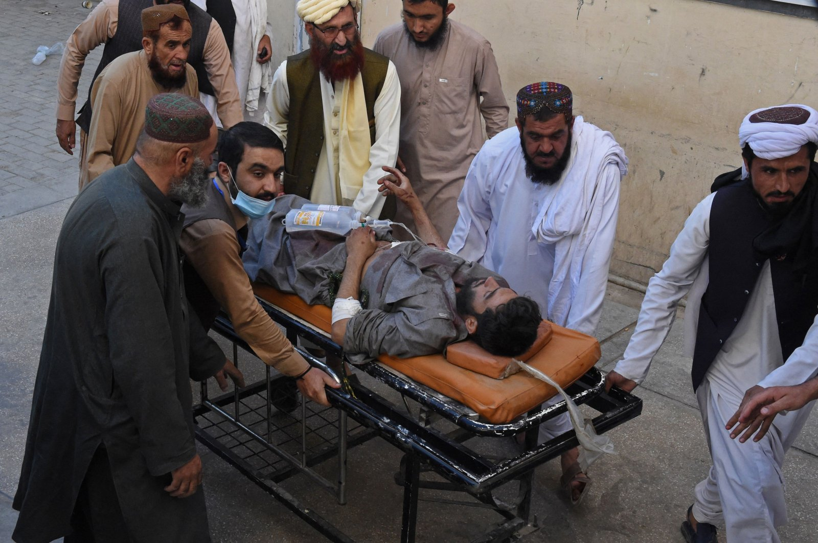 People push a stretcher carrying a victim who was injured in a bomb blast during a pro-Palestinian rally in which six people were killed and another 14 wounded, in Chaman, Balochistan province near the Afghanistan border, Pakistan, May 21, 2021. (AFP Photo)