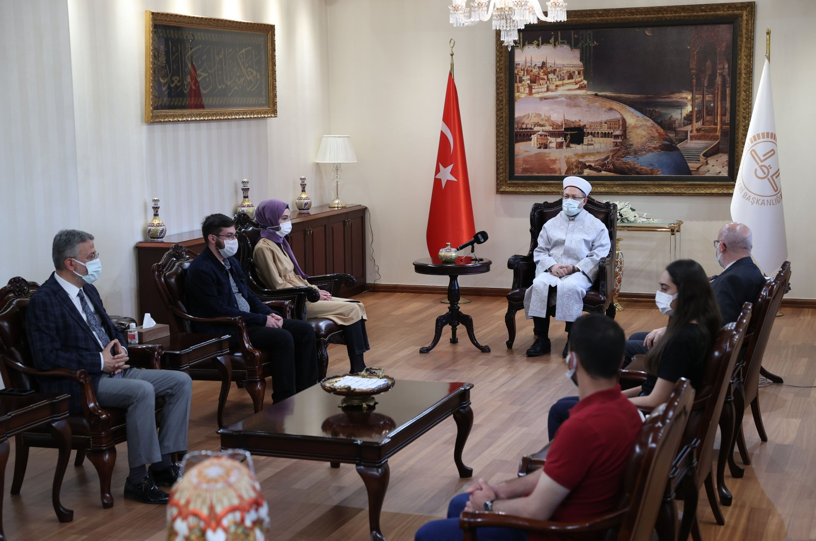 The head of Turkey's Presidency of Religious Affairs (Diyanet) Ali Erbaş (center) speaks to youth in a meeting in Ankara, May 21, 2021. (AA Photo)