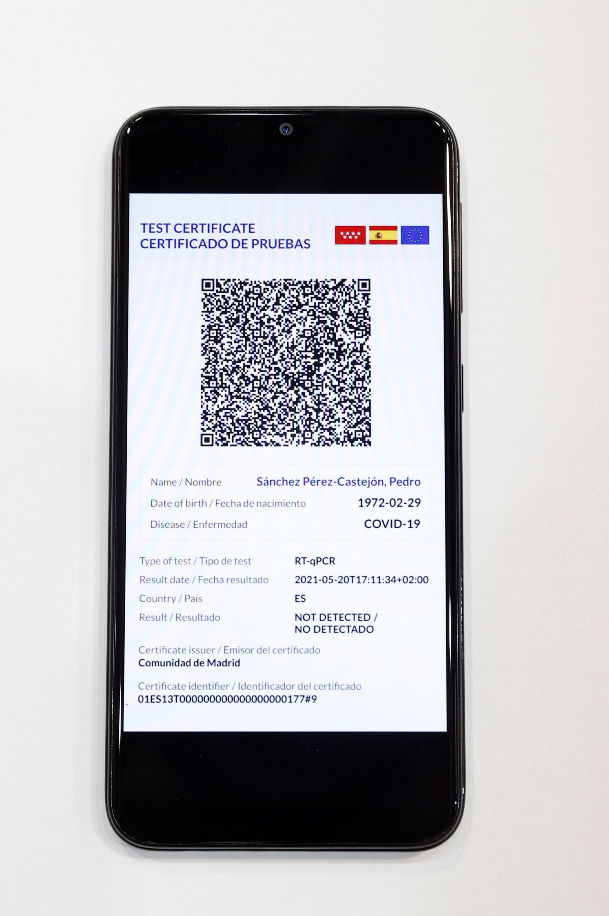 Spanish Prime Minister Pedro Sanchez's Green Digital Certificate shows on a cellphone at the International Tourism Fair Fitur 2021 at the Ifema pavilion, Madrid, Spain, May 21, 2021. (EPA)