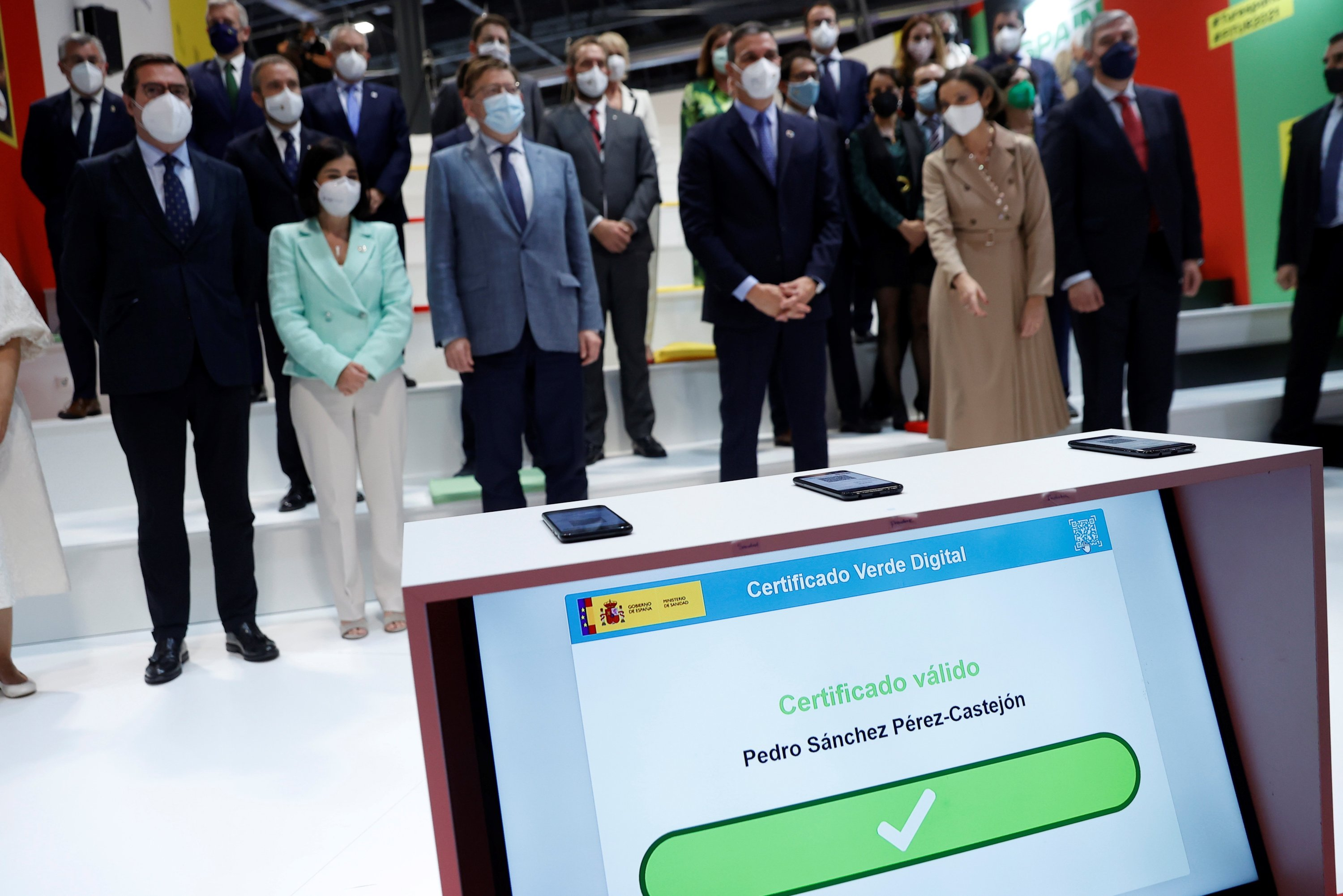 The Green Digital Certificate – a certificate that records that a person has been vaccinated, has passed COVID-19 or has had a negative PCR test – of Spanish Prime Minister Pedro Sanchez (3rd R) shows on a screen that it has been validated, during its presentation at the International Tourism Fair Fitur 2021 at the Ifema pavilion in Madrid, Spain, May 21, 2021. (EPA)
