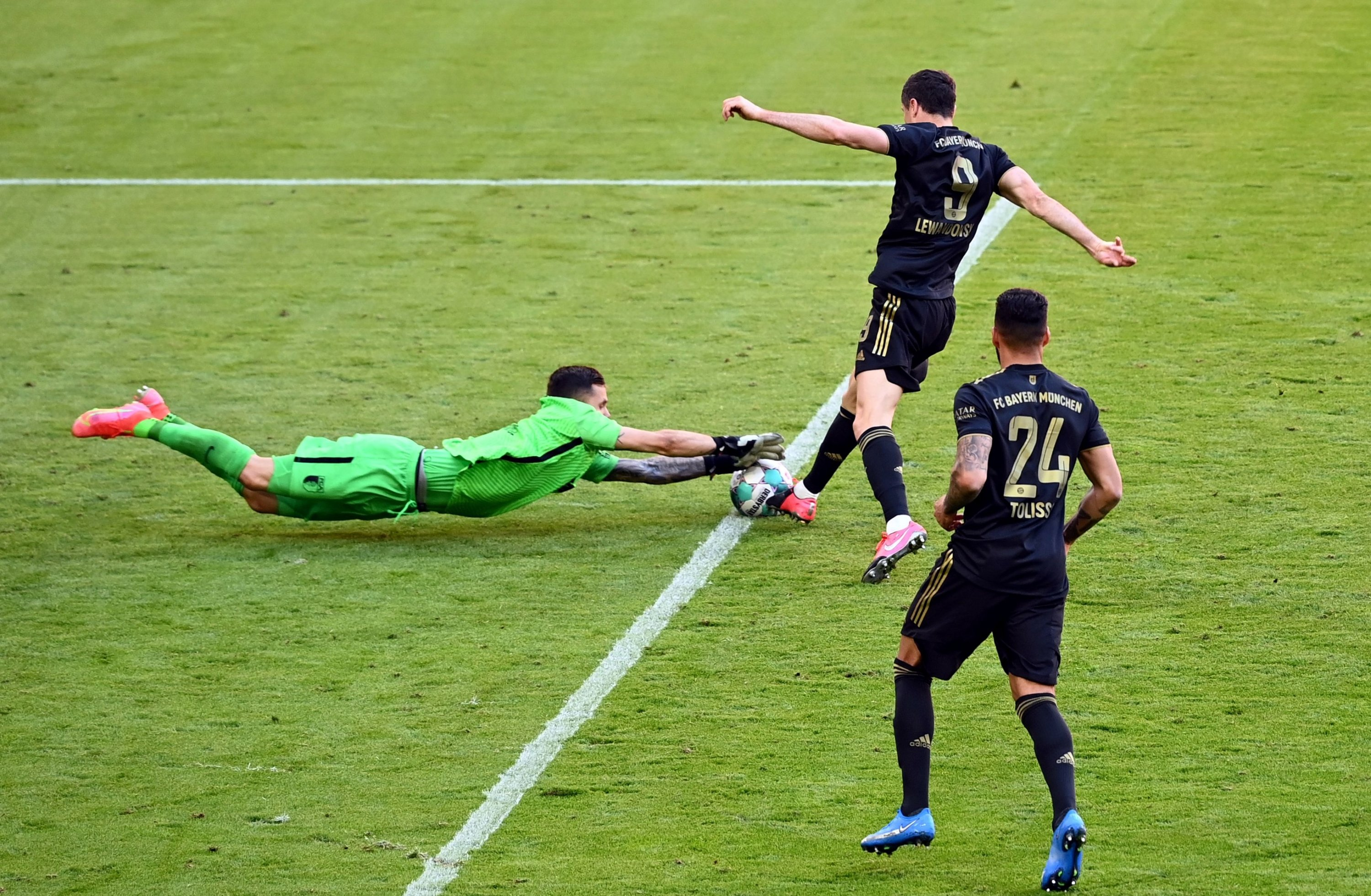 Bayern Munich's Polish forward Robert Lewandowski scores his team's fifth goal 5-2 during a German top division Bundesliga football match against FC Augsburg in at Allianz Arena in Munich, southern Germany, May 22, 2021. (Photo: Sven Hoppe/DFL/Pool via Reuters)