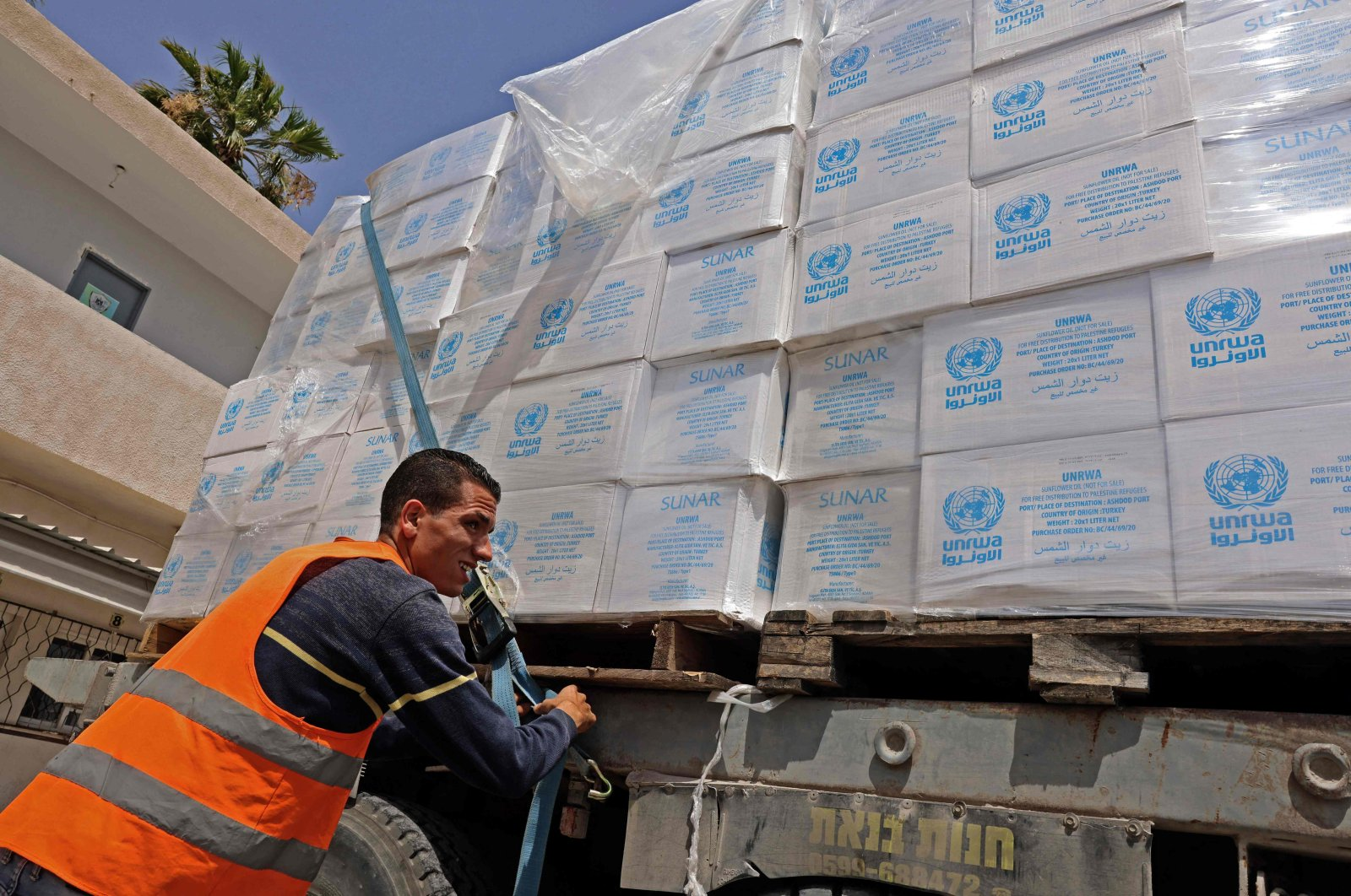 A truck loaded with humanitarian aid, passes into Rafah in the southern Gaza Strip, through the Kerem Shalom crossing, the main passage point for goods entering Gaza from Israel, May 21, 2021. (AFP Photo)