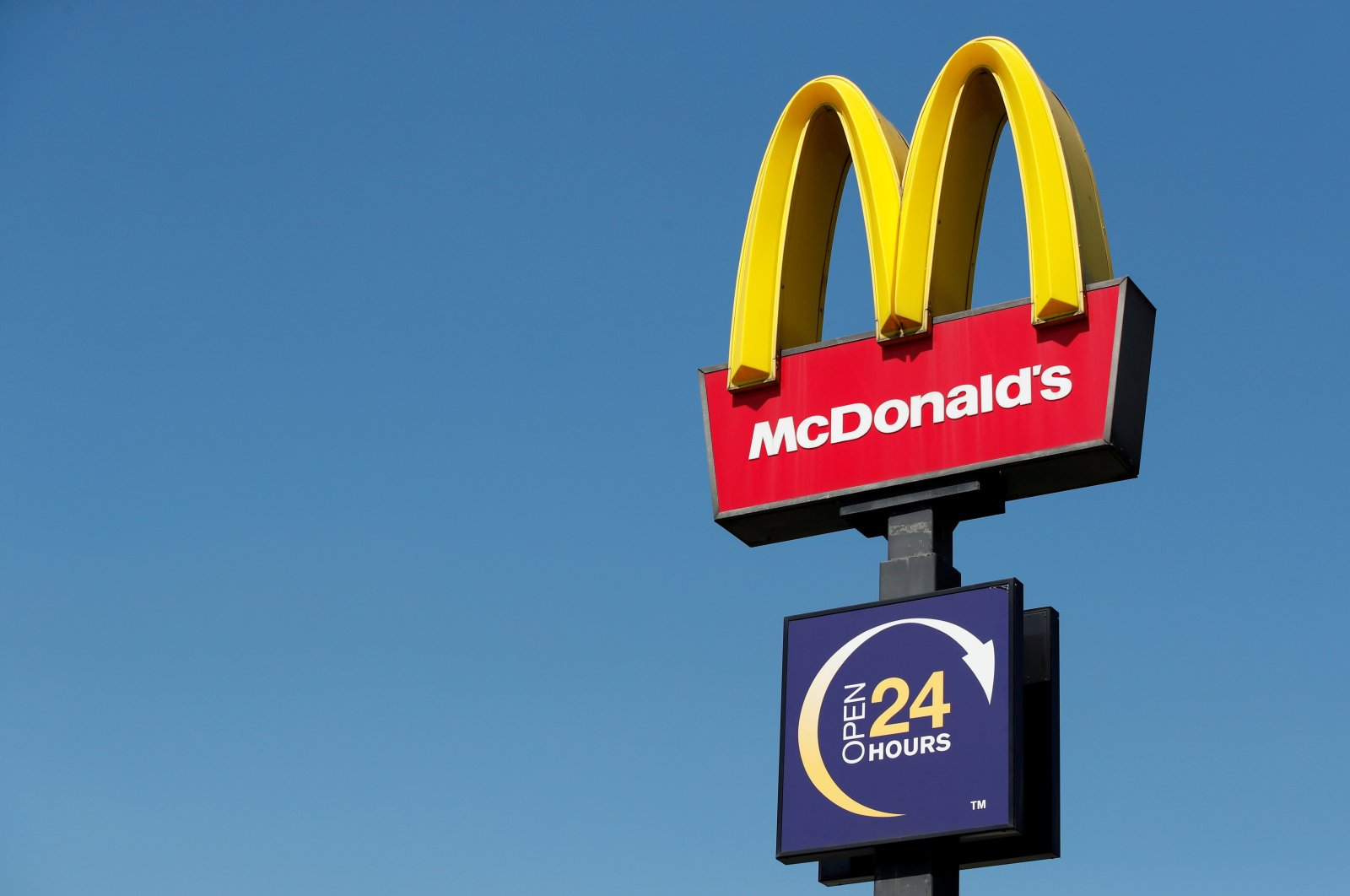 A McDonald's sign stands at a branch in Leicester, England, April 25, 2020. (Reuters Photo)