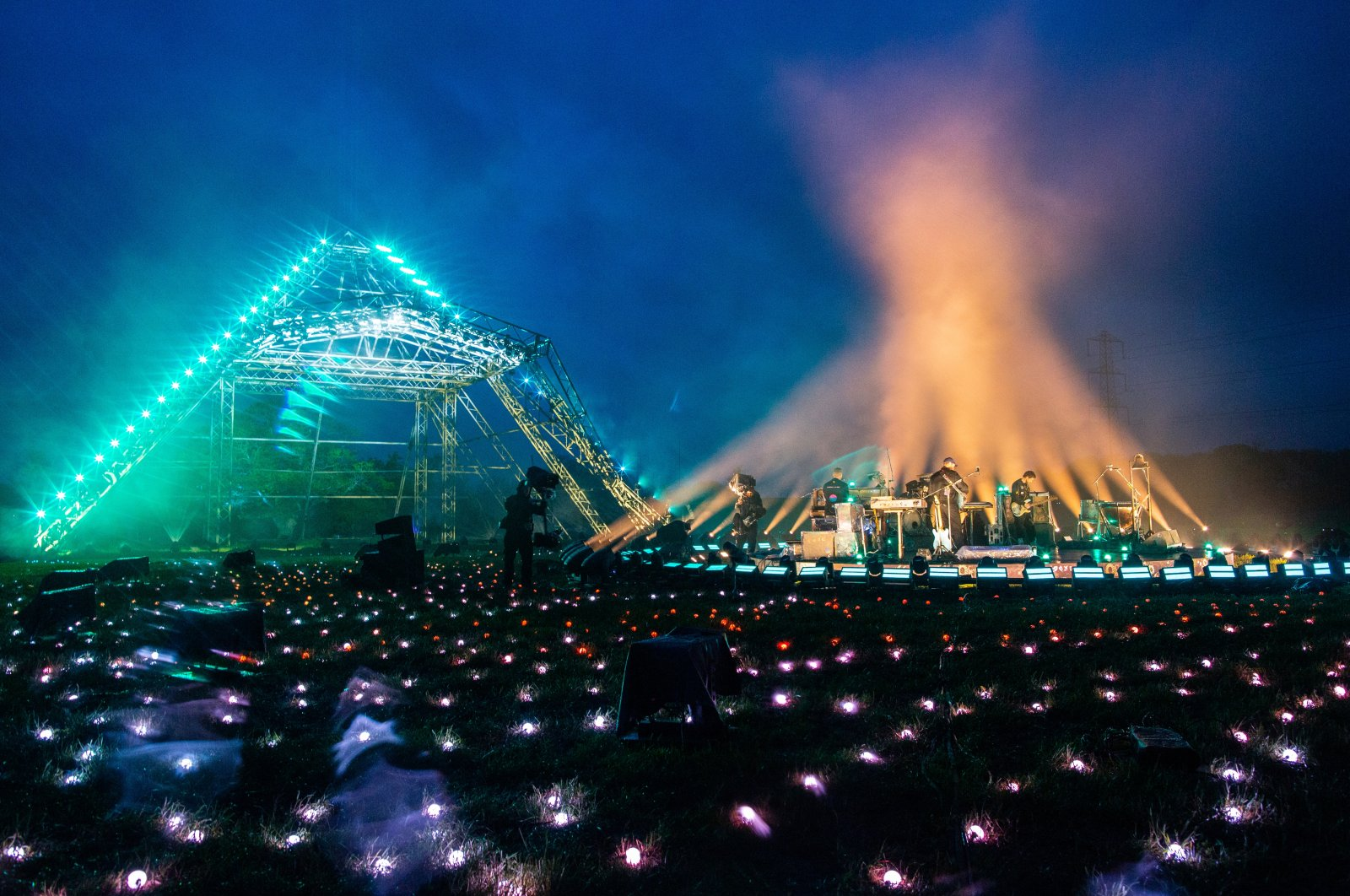 """In this image released on May 22nd, Coldplay performs in front of the main Pyramid Stage as part of the Glastonbury Festival Global Livestream """"Live at Worthy Farm"""" at Worthy Farm, Pilton on May 21, 2021 in Glastonbury, England. (Anna Barclay for Glastonbury Festival via Getty Images)"""