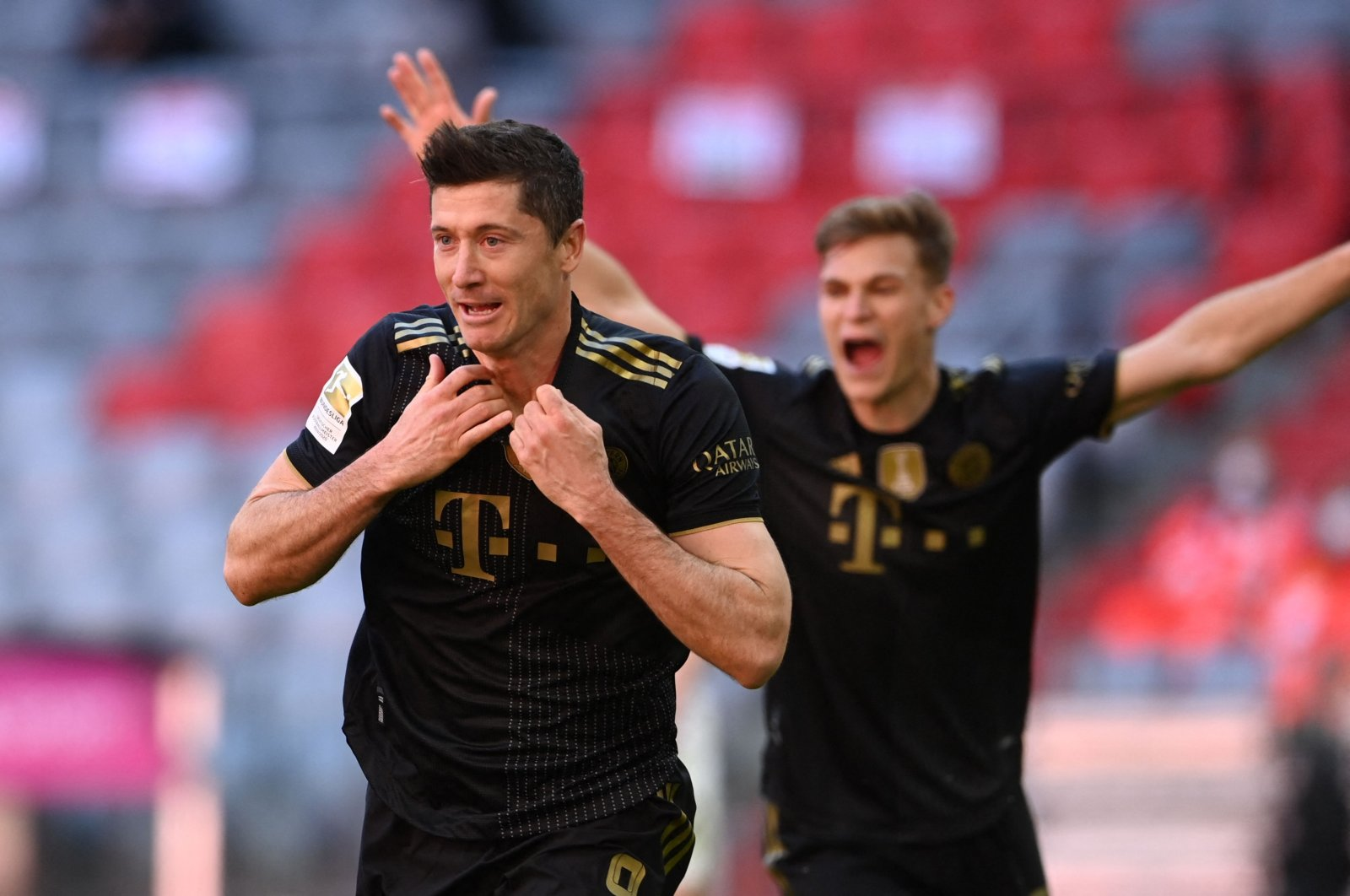 Bayern Munich's Polish forward Robert Lewandowski celebrates scoring his team's fifth goal and his 41st season goal during the German first division Bundesliga football match against FC Augsburg in at Allianz Arena in Munich, southern Germany, May 22, 2021. (Photo by Christof Strache/DFL/Pool via AFP)