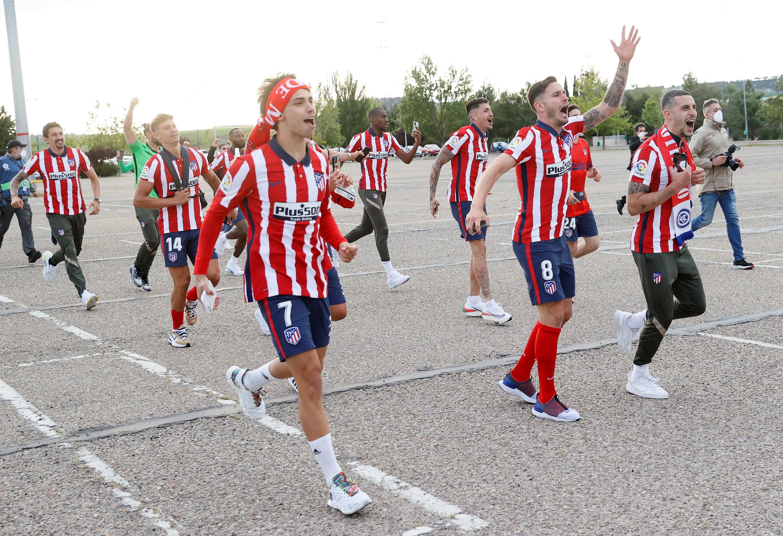 Atletico Madrid players celebrate the La Liga title with supporters outside Jose Zorrilla Stadium, Valladolid, Spain, May 22, 2021. (EPA Photo)