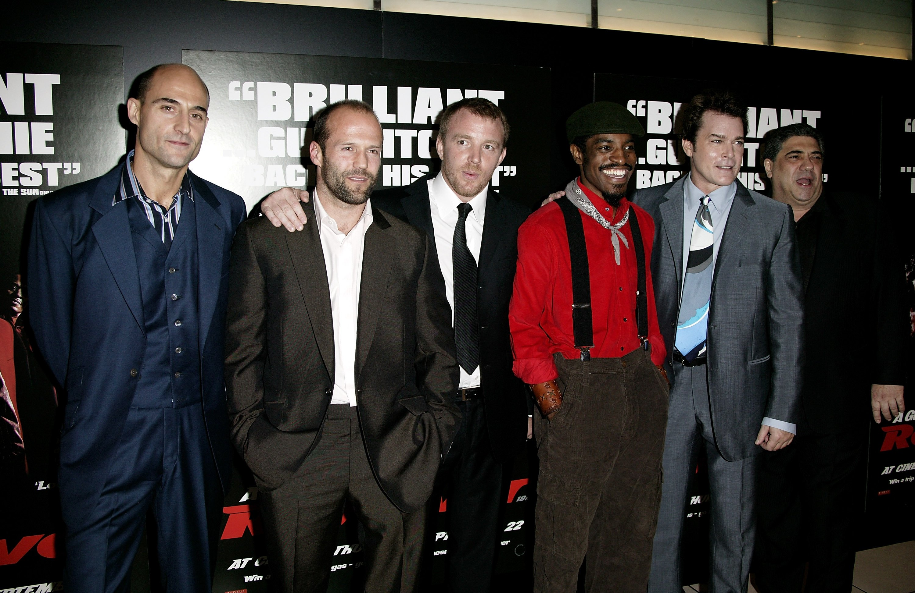 From left to right, actors Mark Strong, Jason Statham, director Guy Ritchie, actors Andre 'Andre 3000' Benjamin, Ray Liotta and Vincent Pastore arrive at the U.K. Premiere of 'Revolver' at the Odeon Leicester Square, London, England, Sept. 20, 2005.  (Getty Images)