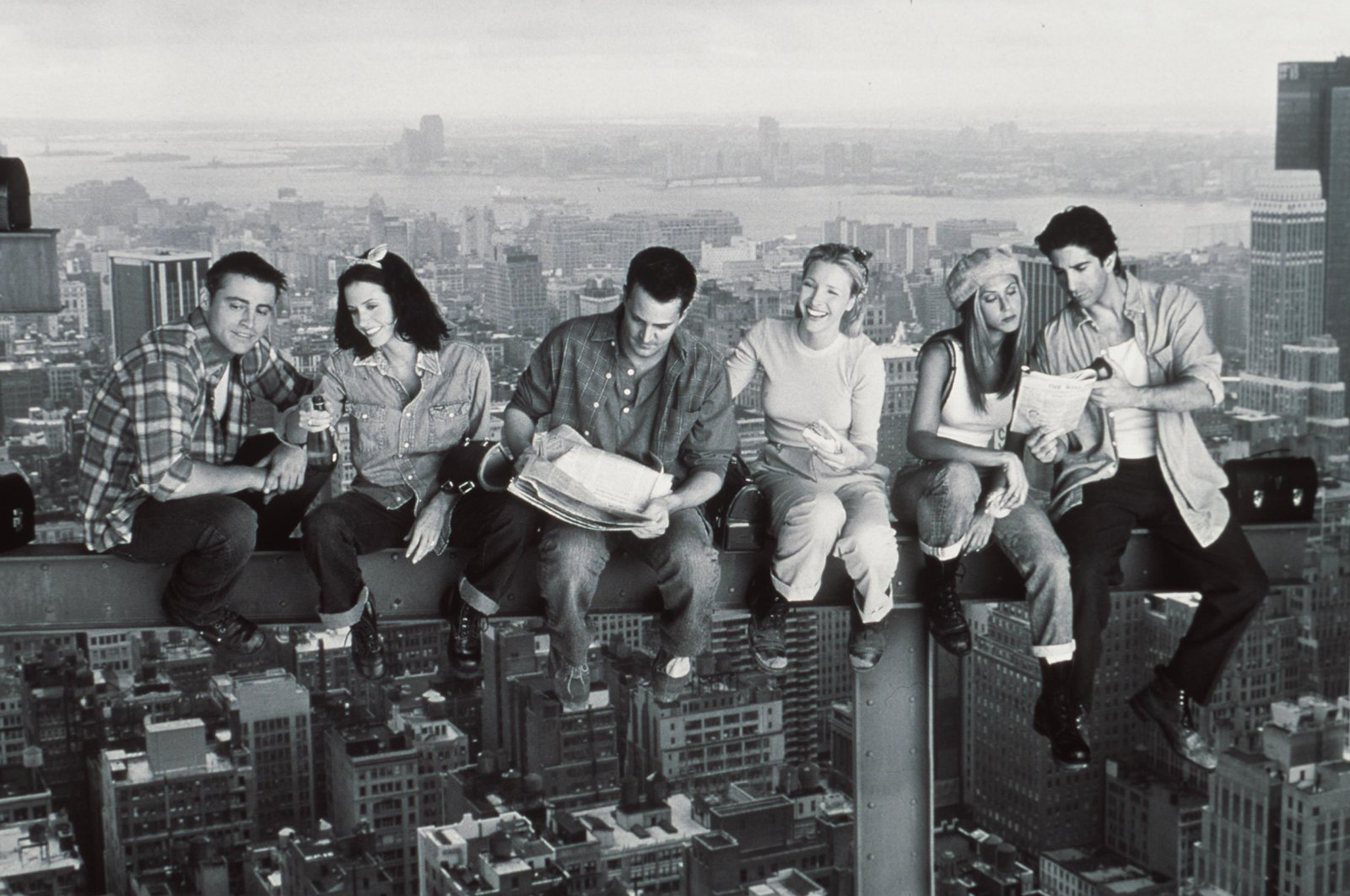 An illustration photo of the main cast of Friends sitting on a building under construction. (Photo By Getty Images)