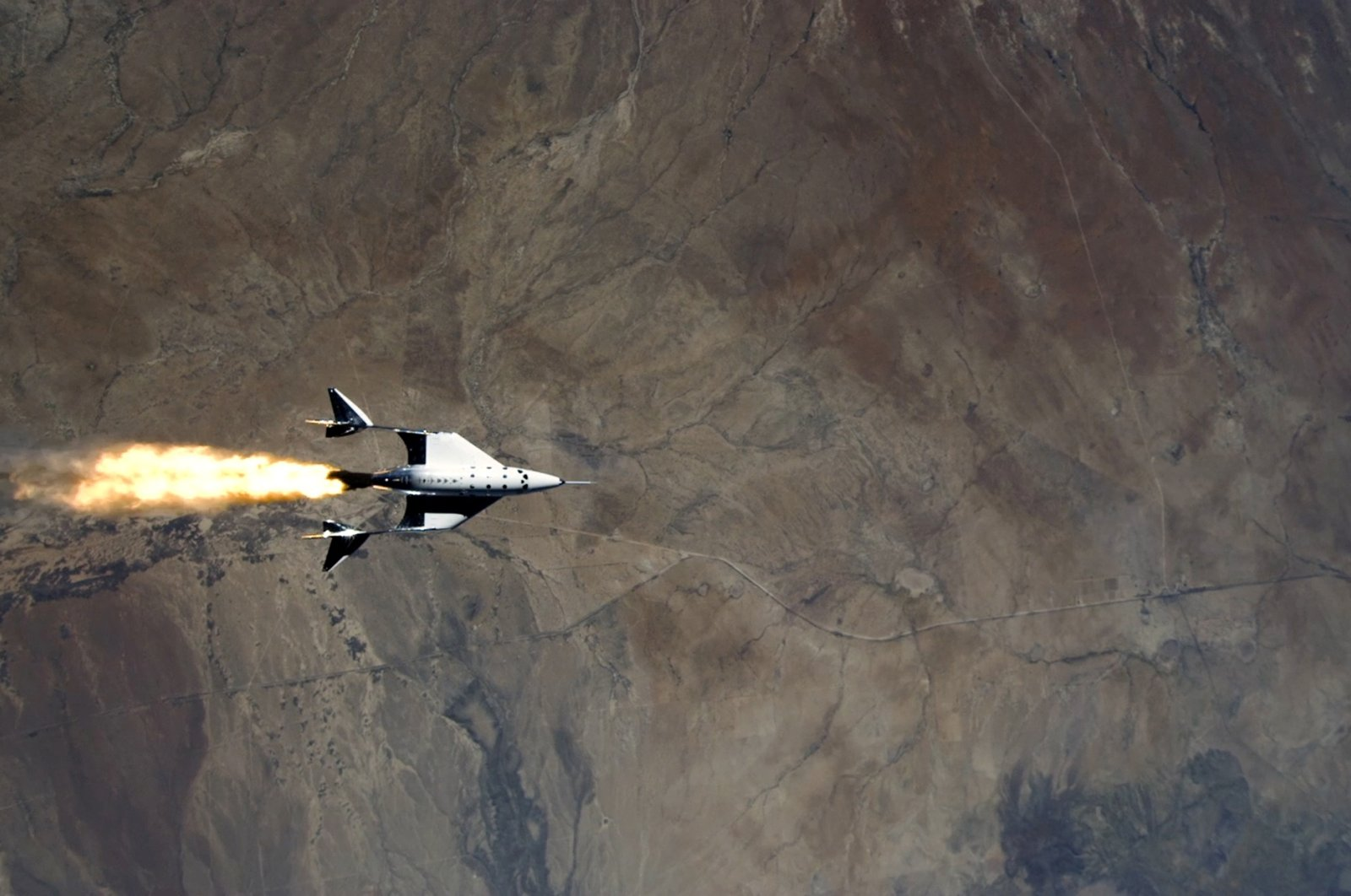 This still image from a video shows Virgin Galactic's VSS Unity starting its engines after release from its mothership as it commences its first spaceflight after launch from Spaceport America, New Mexico, U.S., May 22, 2021. (Reuters Photo)