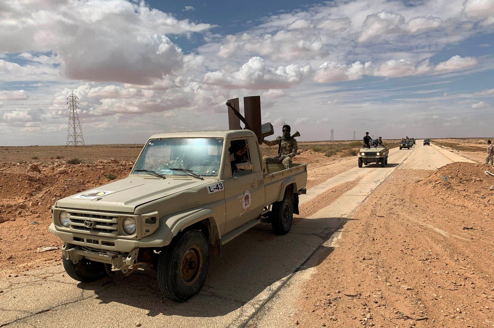 Troops loyal to Libya's internationally recognized government patrol the area in Zamzam, near Abu Qareen, Libya, Sept. 15, 2020. (Reuters Photo)