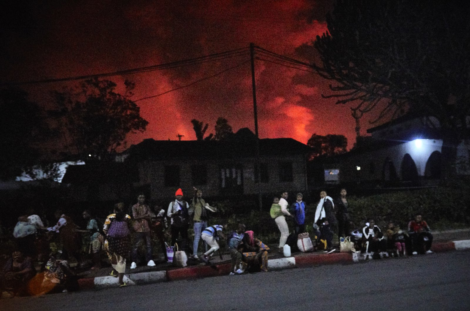 Congolese residents flee from Mount Nyiragongo as it erupts over their city Goma, in the Democratic Republic of the Congo, May 22, 2021. (EPA-EFE Photo)