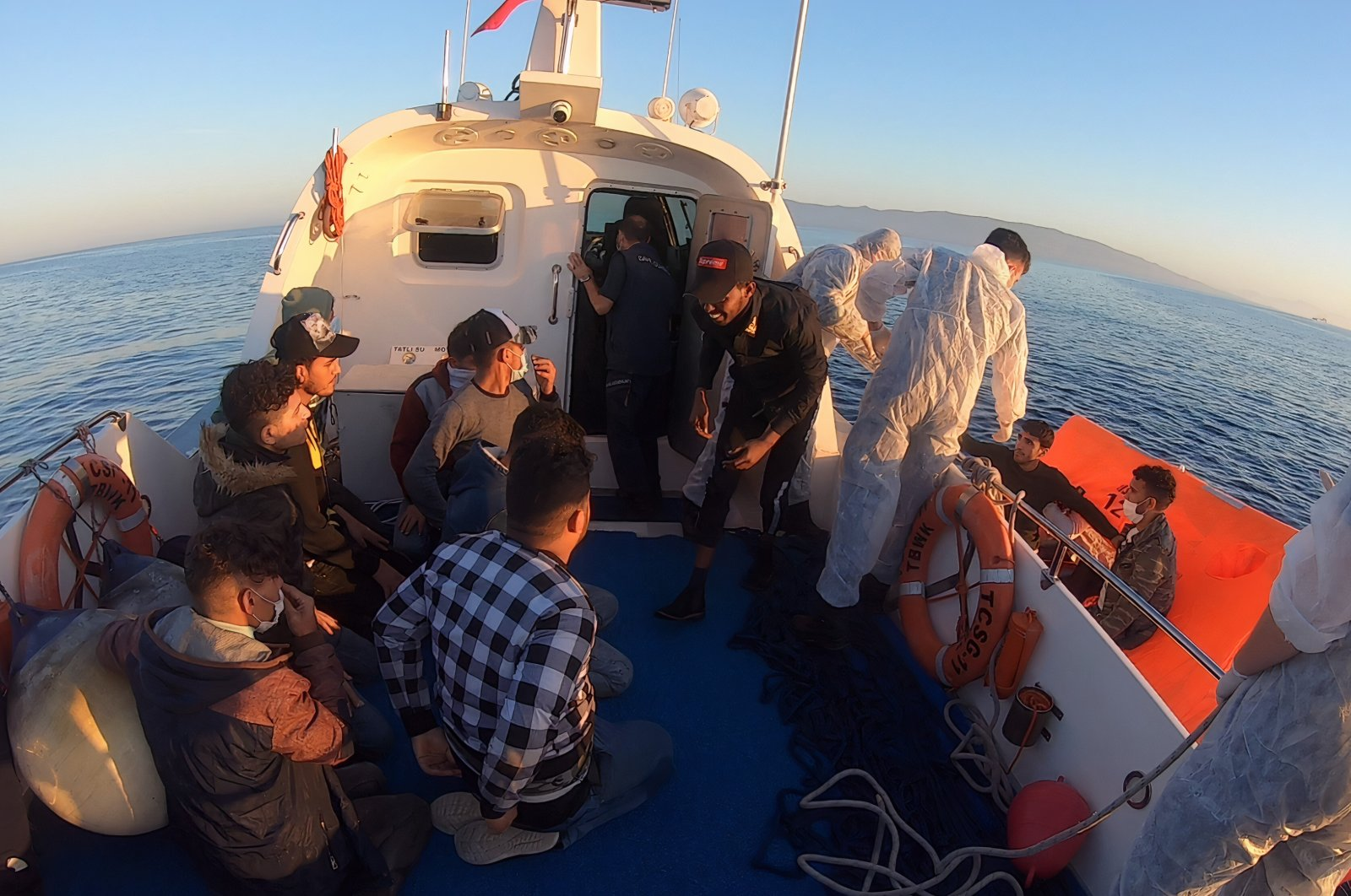 Some 25 irregular migrants pushed back by Greece were rescued by the Turkish coast guard near the coast of Muğla province's Datça district, Turkey, May 20, 2021. (DHA Photo)