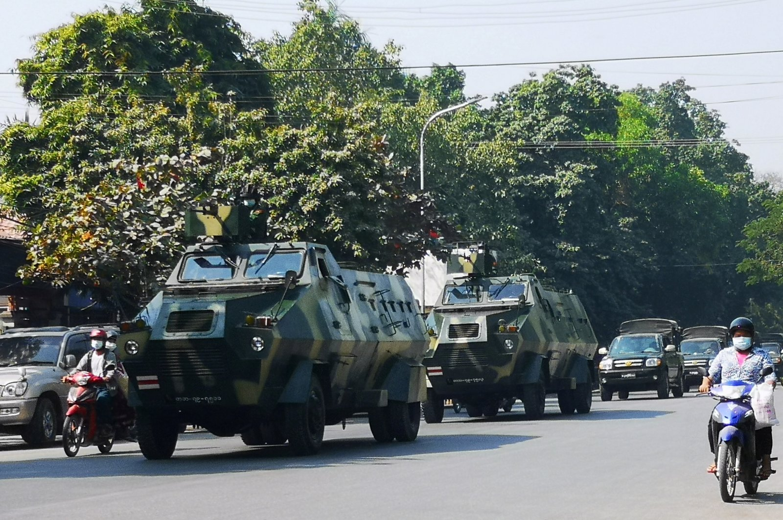 Myanmar Army armored vehicles drive past a street after they seized power in a coup in Mandalay, Myanmar February 2, 2021. (Reuters Photo)