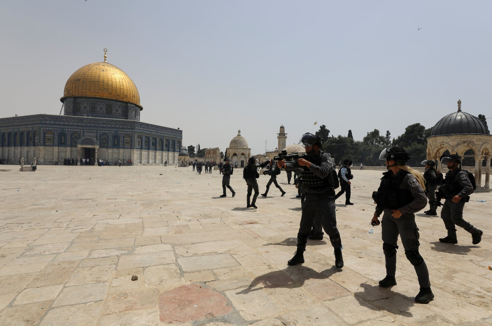 Israeli security forces stand in position during clashes with Palestinians at the compound that houses Al-Aqsa Mosque, known to Muslims as the Noble Sanctuary and to Jews as Temple Mount, in the Old City neighborhood of East Jerusalem, occupied Palestine, May 21, 2021. (Reuters Photo)