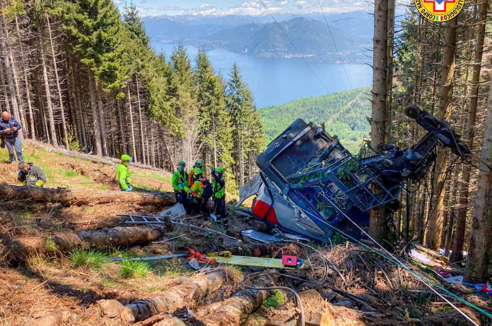 A handout photo made available by the press office of the Corpo Nazionale Soccorso Alpino Speleologico (CNSAS), Italy's national mountain rescue service, shows the scene of a cable car accident near Lake Maggiore, in Verbania, northern Italy, May 23, 2021. (EPA Photo)