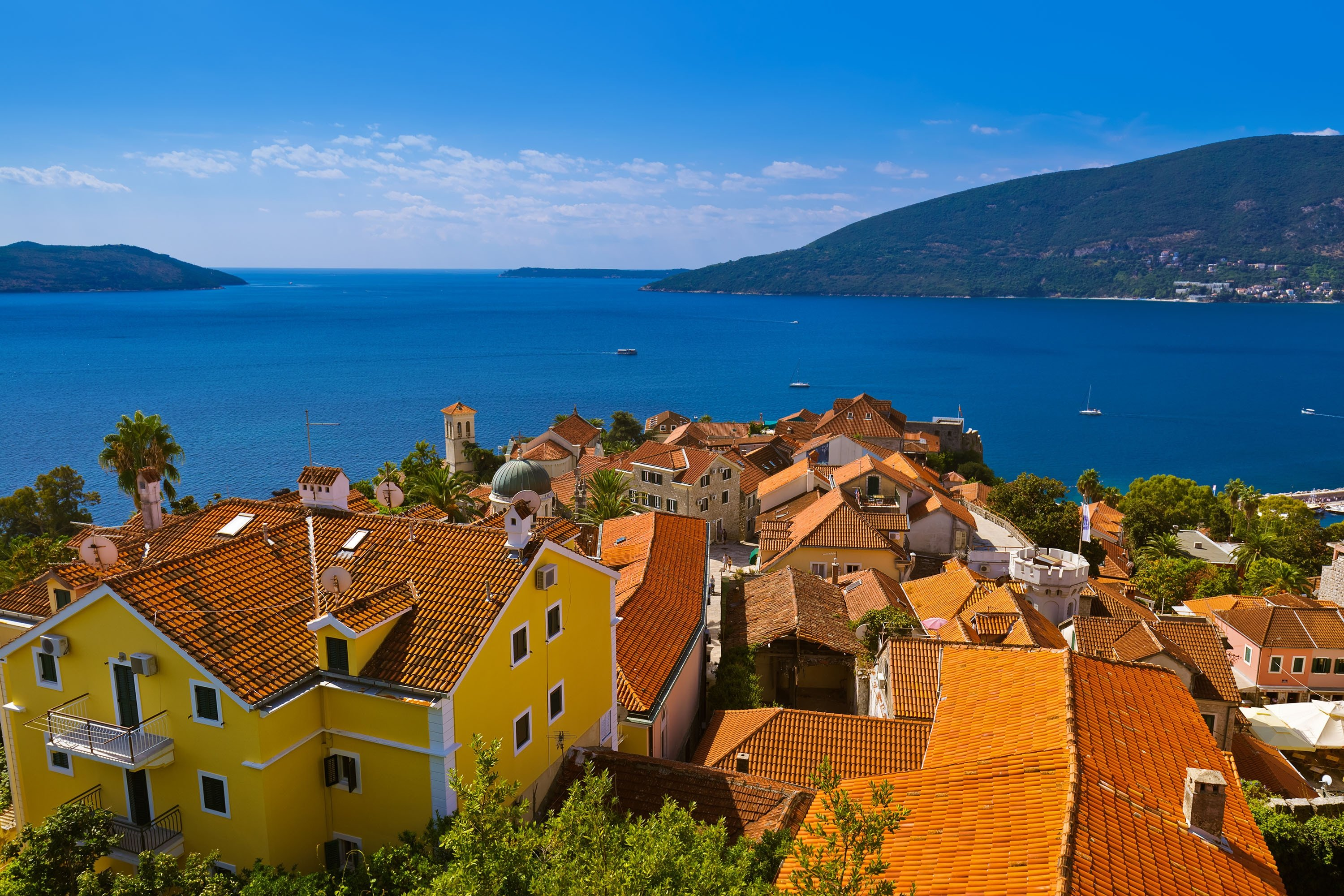 Herceg Novi's historical architecture speckles the landscape in front of the Bay of Kotor, Montenegro. (Shutterstock Photo)