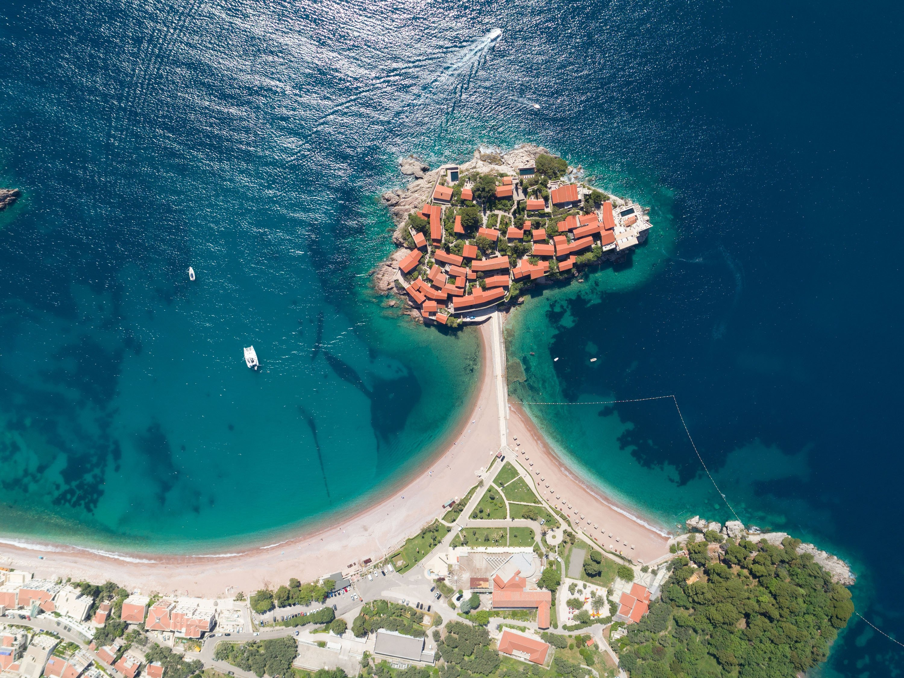 The Adriatic Sea surrounds the small Sveti Stefan islet next to the mainland of Montenegro. (Shutterstock Photo)
