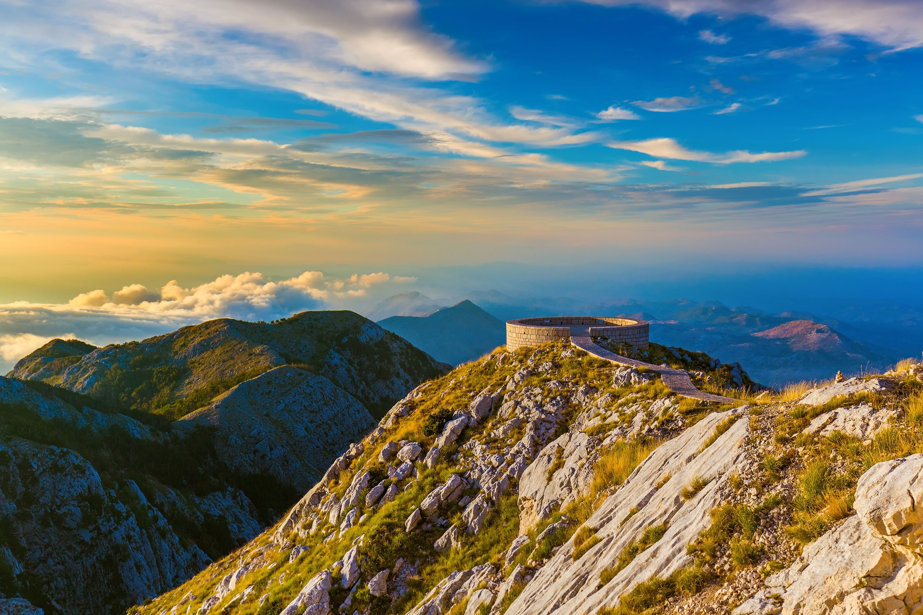 From Mount Lovcen National Park, the mountainous landscape reaches for the clouds at sunset in southwestern Montenegro. (Shutterstock Photo)