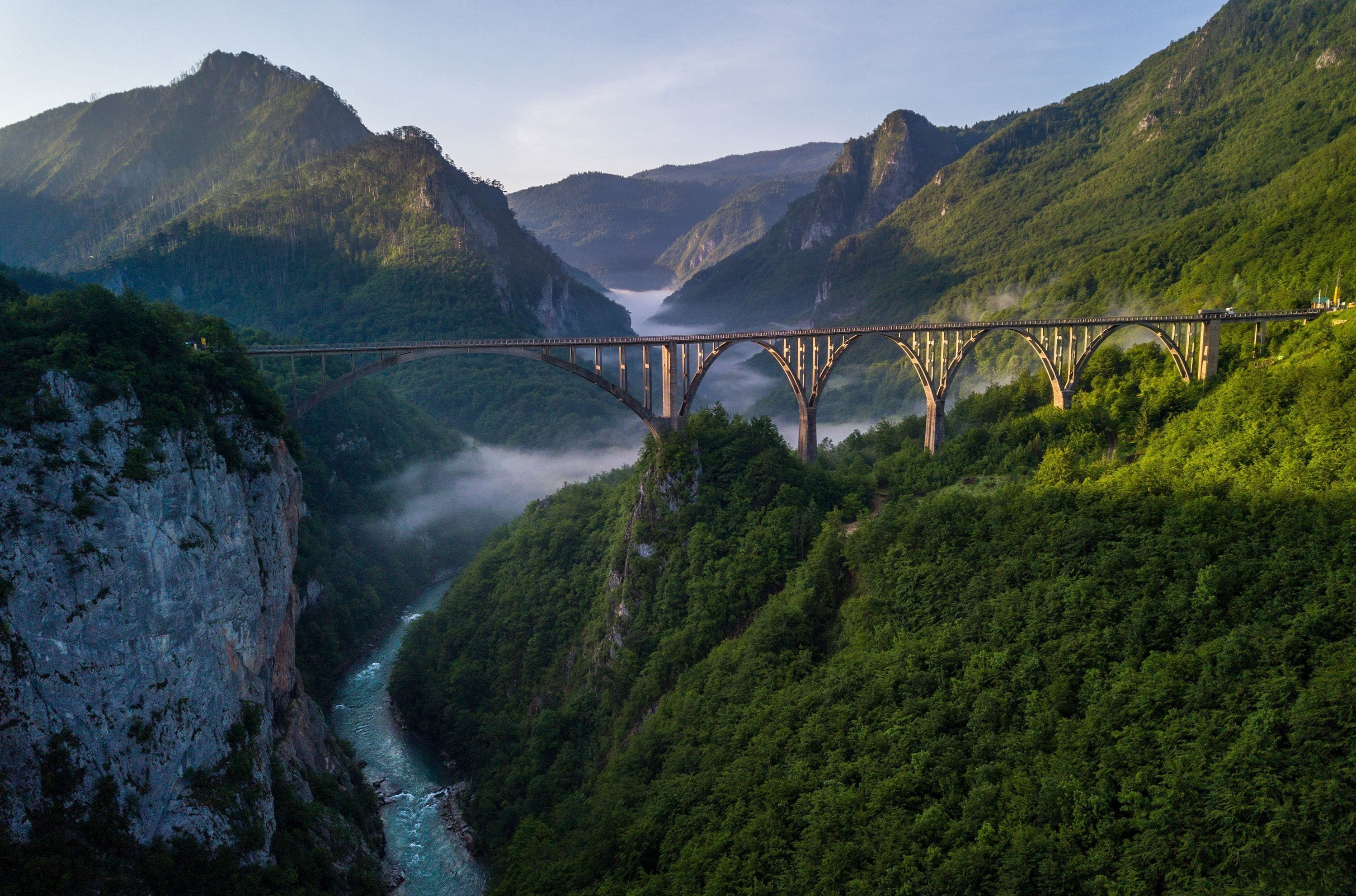 On a beautiful misty morning, the Durdevica bridge stands over the River Tara, Montenegro. (Shutterstock Photo)